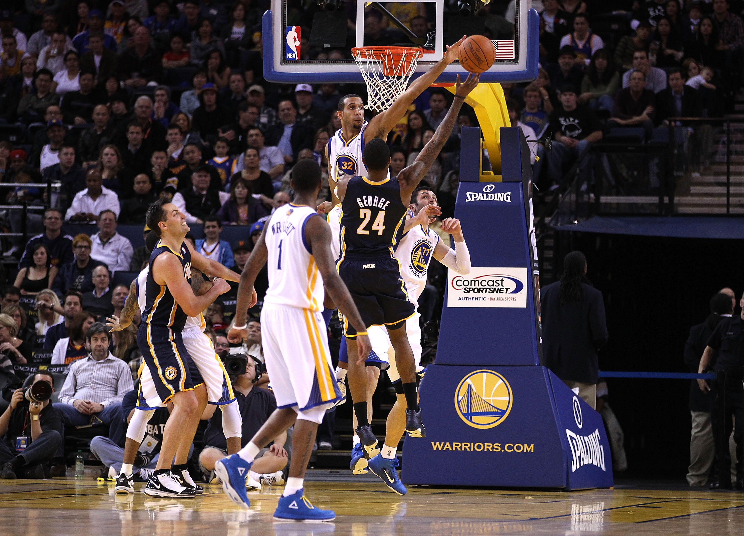 OAKLAND, CA - JANUARY 19:  Paul George #24 of the Indiana Pacers has a shot blocked by Brandan Wright #32 of the Golden State Warriors at Oracle Arena on January 19, 2011 in Oakland, California.  NOTE TO USER: User expressly acknowledges and agrees that,