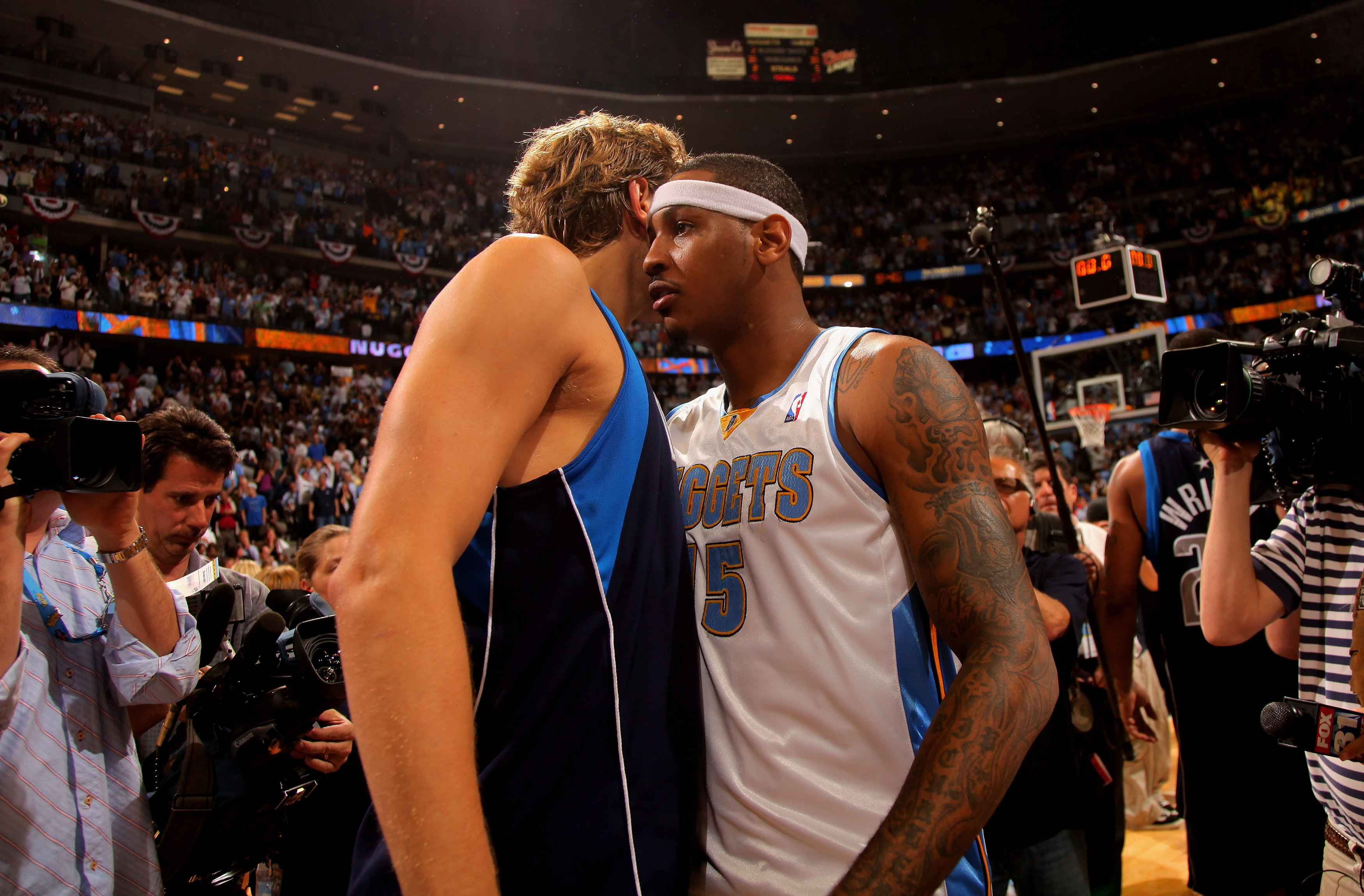 DENVER - MAY 13:  Carmelo Anthony #15 of the Denver Nuggets and Dirk Nowitzki #41 of the Dallas Mavericks exchange words on the court after Game Five of the Western Conference Semifinals during the 2009 NBA Playoffs at Pepsi Center on May 13, 2009 in Denv