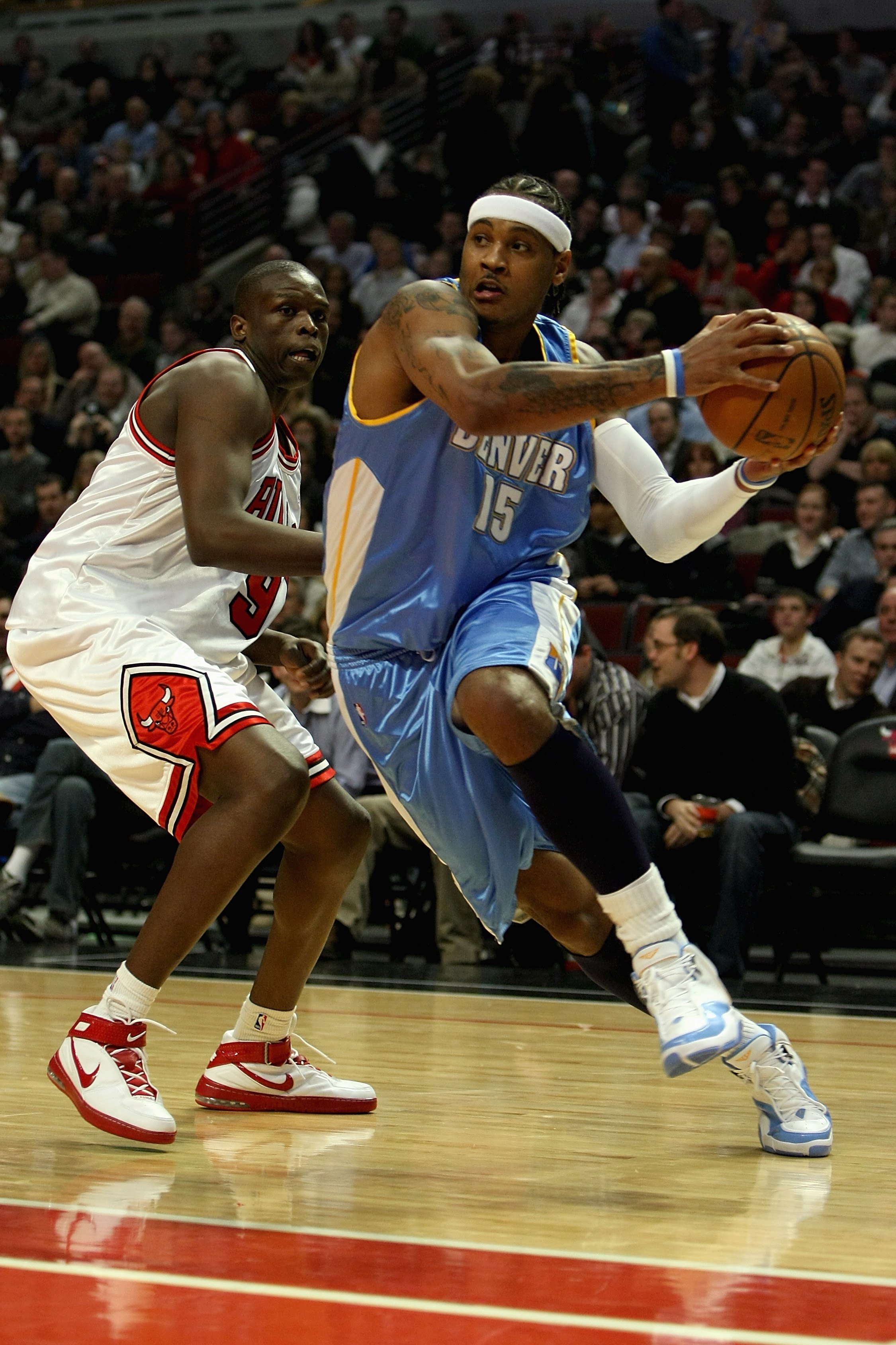 CHICAGO - FEBRUARY 22:  Carmelo Anthony #15 of the Denver Nuggets drives to the basket past Luol Deng #9 of the Chicago Bulls during the game on February 22, 2008 at the United Center in Chicago, Illinois. The Bulls won 135-121. NOTE TO USER: User express