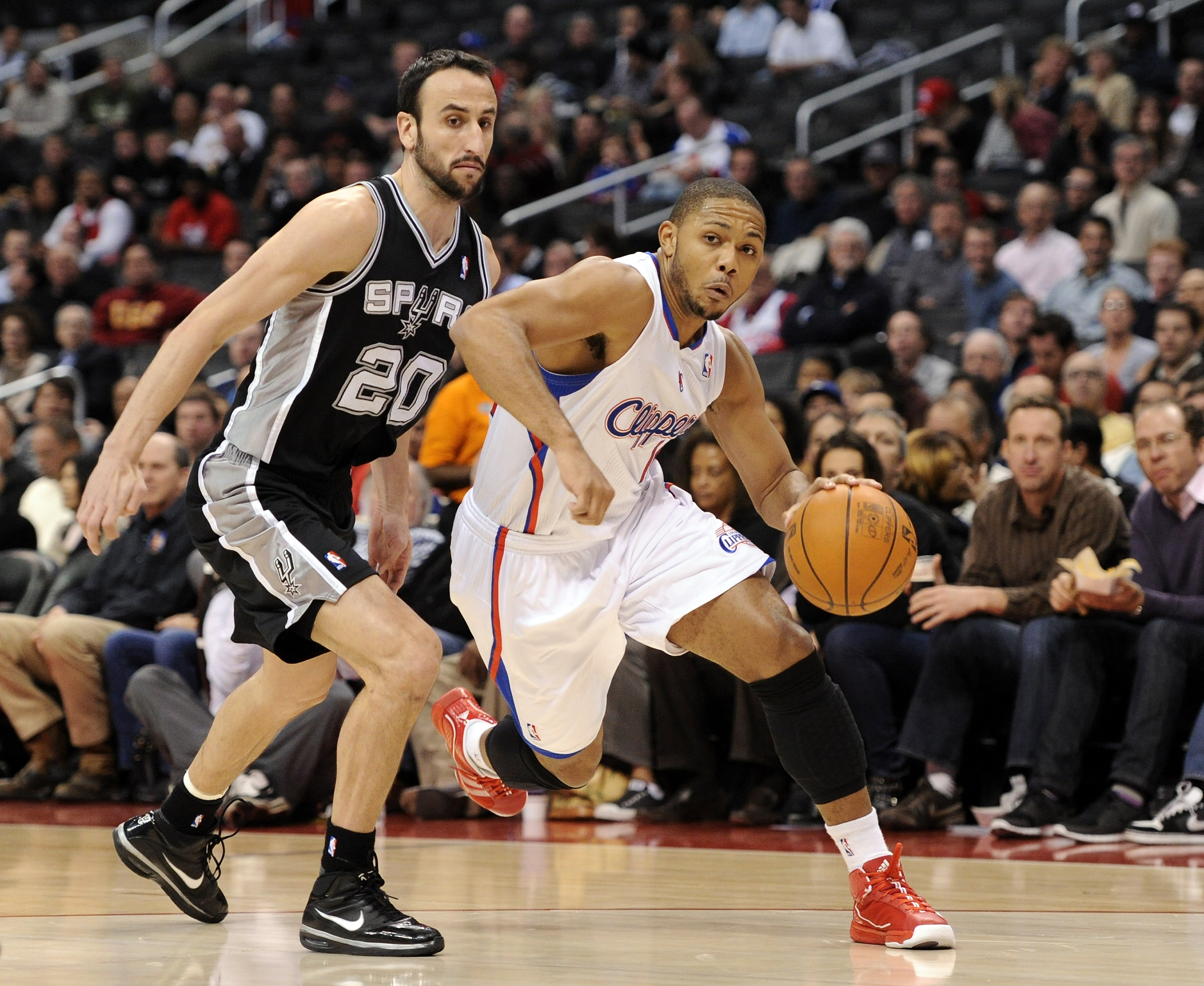 LOS ANGELES, CA - DECEMBER 01:  Eric Gordon #10 of the Los Angeles Clippers drives dribbles around Manu Ginobili #20 of the San Antonio Spurs during the game at the Staples Center on December 1, 2010 in Los Angeles, California.  NOTE TO USER: User express
