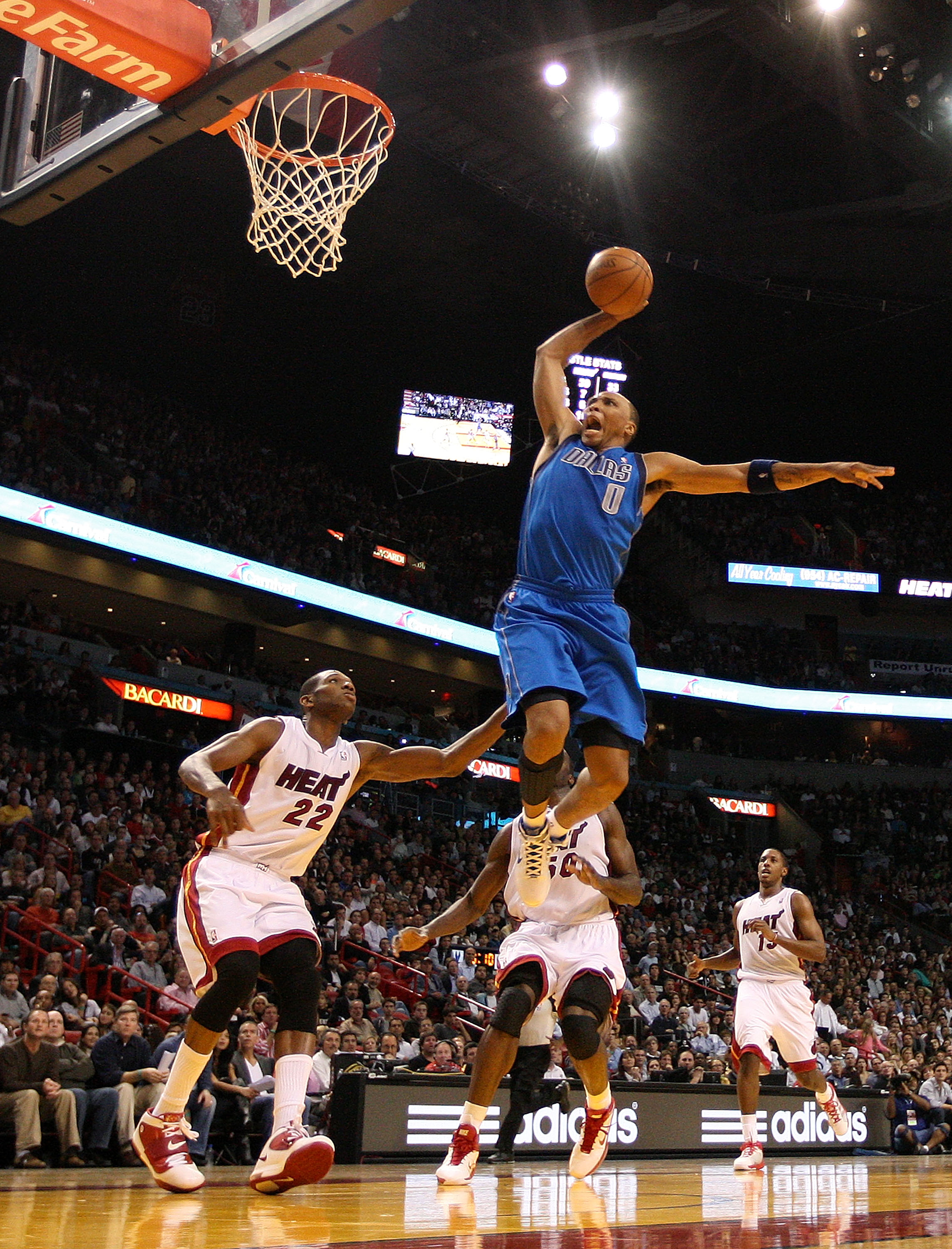 MIAMI, FL - DECEMBER 20:  Shawn Marion #0 of the Dallas Mavericks dunks over James Jones #22 of the Miami Heat during a game at American Airlines Arena on December 20, 2010 in Miami, Florida. NOTE TO USER: User expressly acknowledges and agrees that, by d