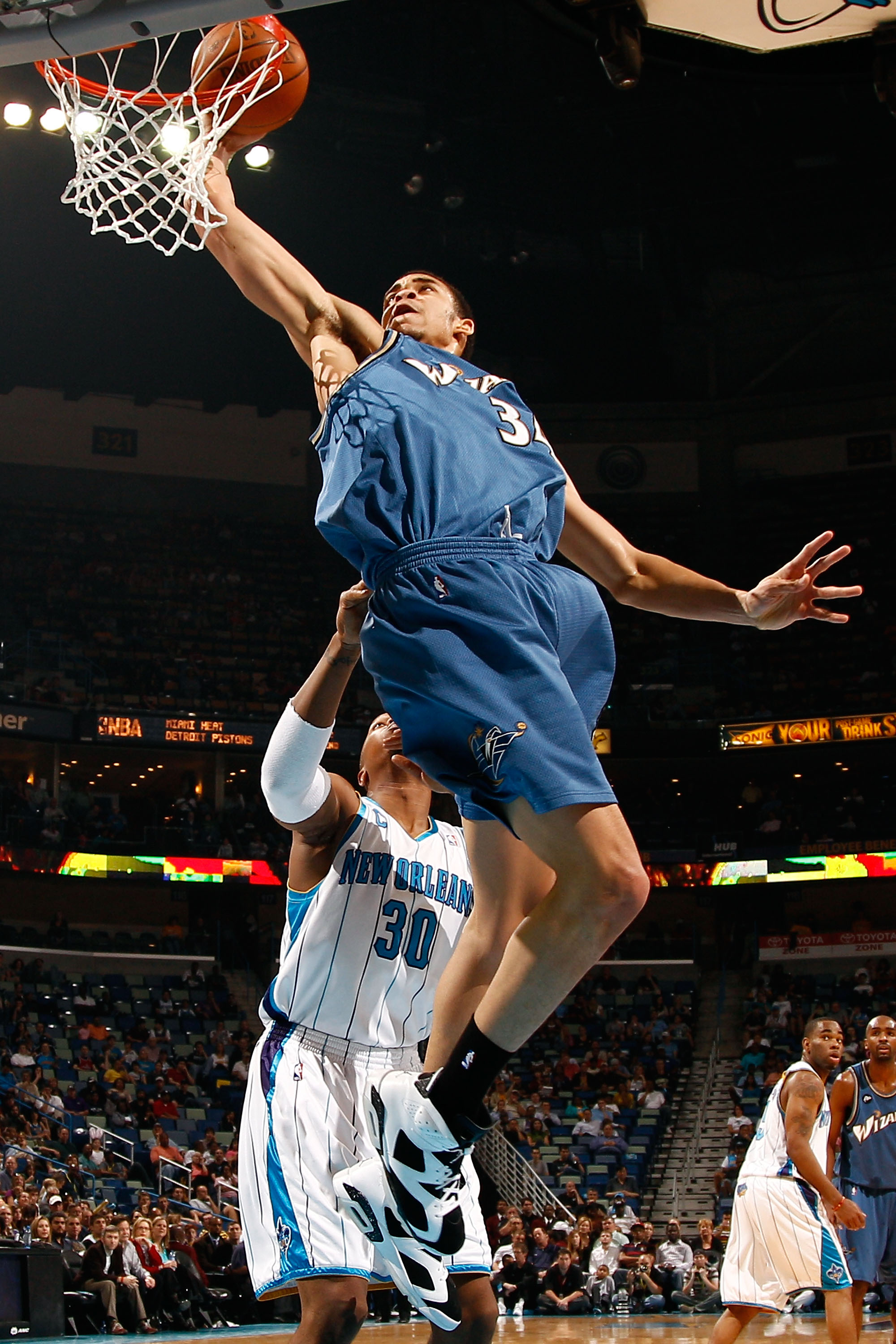 NEW ORLEANS - MARCH 31:  JaVale McGee #34 of the Washington Wizards attempts a shot over David West #30 of the New Orleans Hornets at New Orleans Arena on March 31, 2010 in New Orleans, Louisiana.  NOTE TO USER: User expressly acknowledges and agrees that