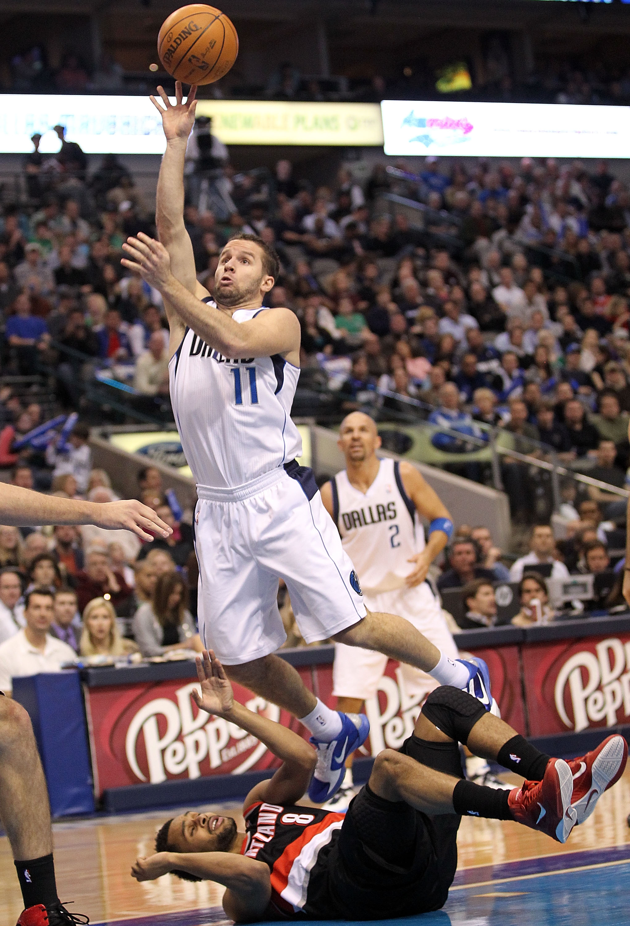 DALLAS, TX - JANUARY 04:  Guard Jose Juan Barea #11 of the Dallas Mavericks takes a shot against Patrick Mills #8 of the Portland Trail Blazers at American Airlines Center on January 4, 2011 in Dallas, Texas.  NOTE TO USER: User expressly acknowledges and
