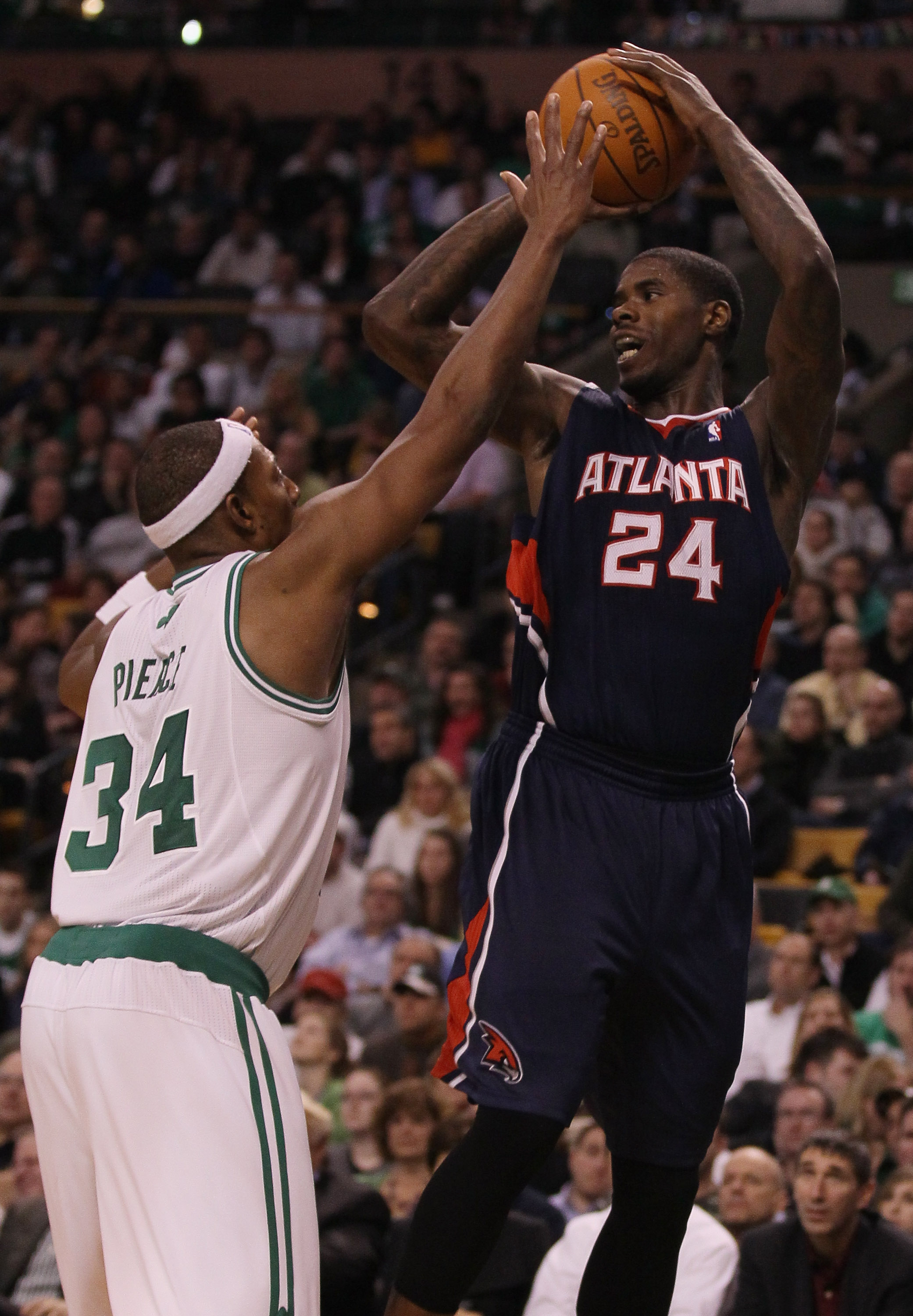 BOSTON, MA - DECEMBER 16:  Marvin Williams #24 of the Atlanta Hawks looks to pass as Paul Pierce #34 of the Boston Celtics defends on December 16, 2010 at the TD Garden in Boston, Massachusetts. The Celtics defeated the Hawks 102-90. NOTE TO USER: User ex