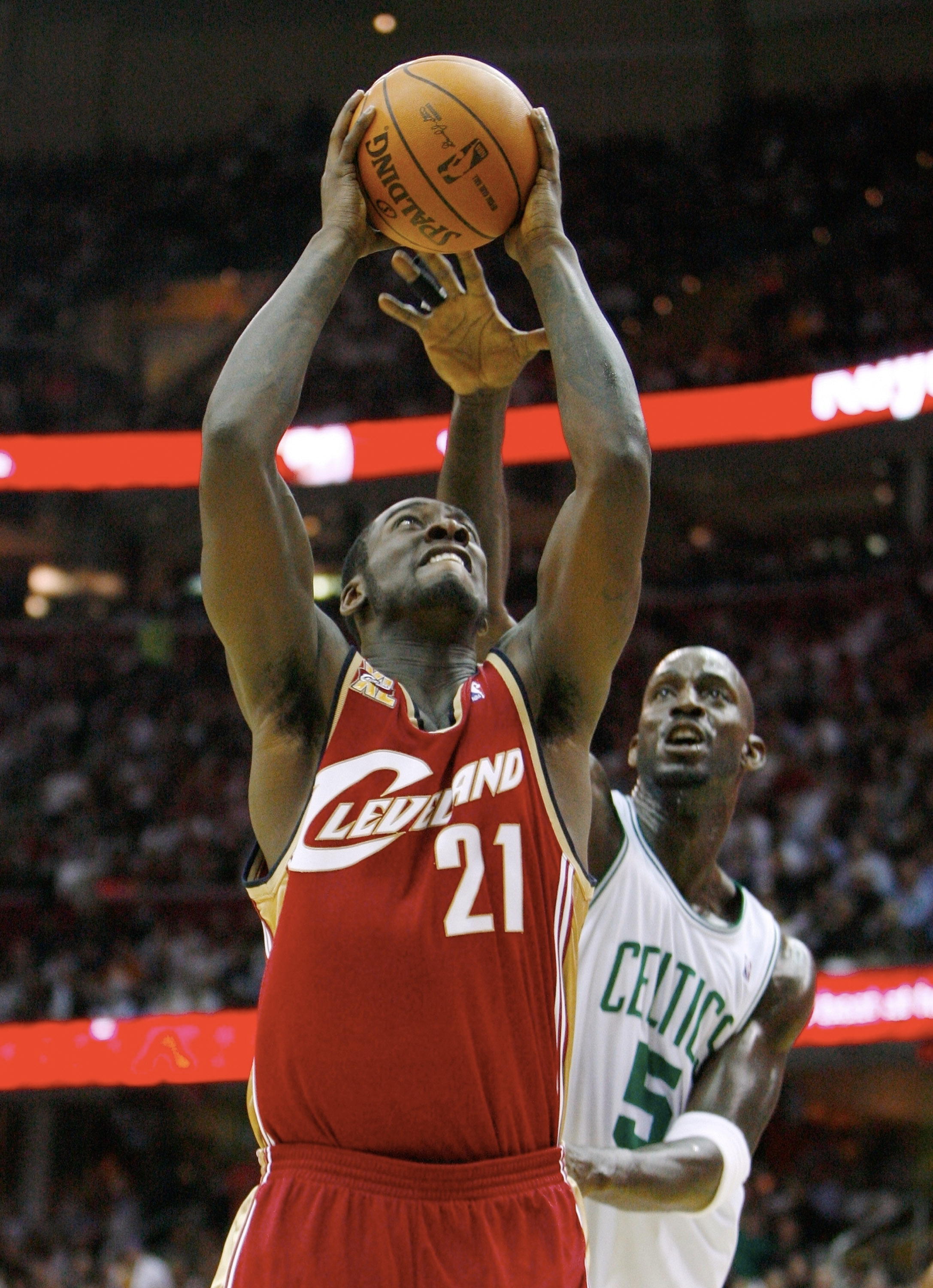 CLEVELAND - OCTOBER 27:  J.J. Hickson #21 of the Cleveland Cavaliers puts up a shot against Kevin Garnett #5 of the Boston Celtics during the season opener at Quicken Loans Arena on October 27, 2009 in Cleveland, Ohio.  NOTE TO USER: User expressly acknow