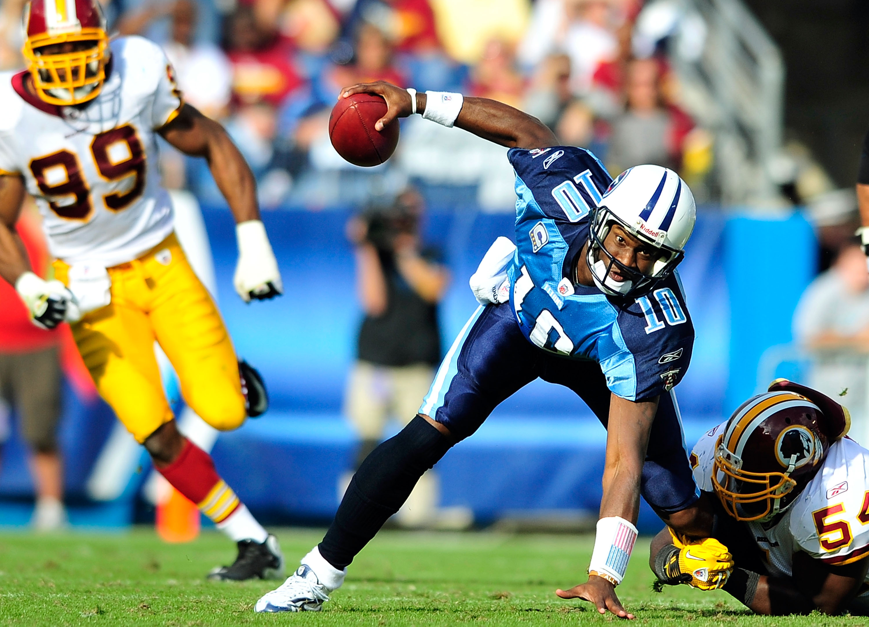 NASHVILLE, TN - NOVEMBER 21:  Quarterback Vince Young #10 of the Tennessee Titans scrambles away from H.B. Blades #54 of the Washington Redskins at LP Field on November 21, 2010 in Nashville, Tennessee. The Redskins won 19-16 in overtime.  (Photo by Grant