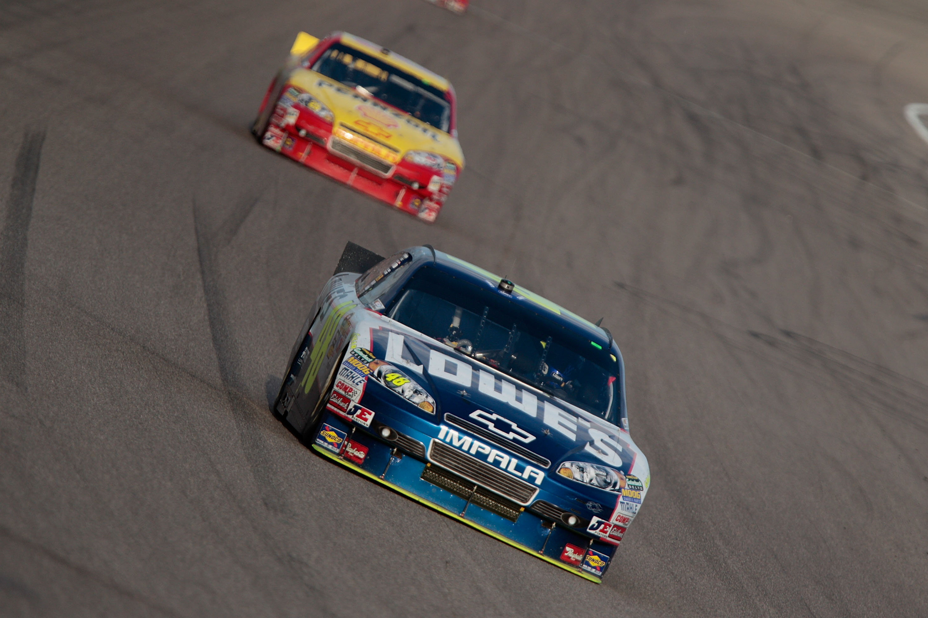 HOMESTEAD, FL - NOVEMBER 21:  Jimmie Johnson, driver of the #48 Lowe's Chevrolet, leads Kevin Harvick, driver of the #29 Shell/Pennzoil Chevrolet, during the NASCAR Sprint Cup Series Ford 400 at Homestead-Miami Speedway on November 21, 2010 in Homestead,