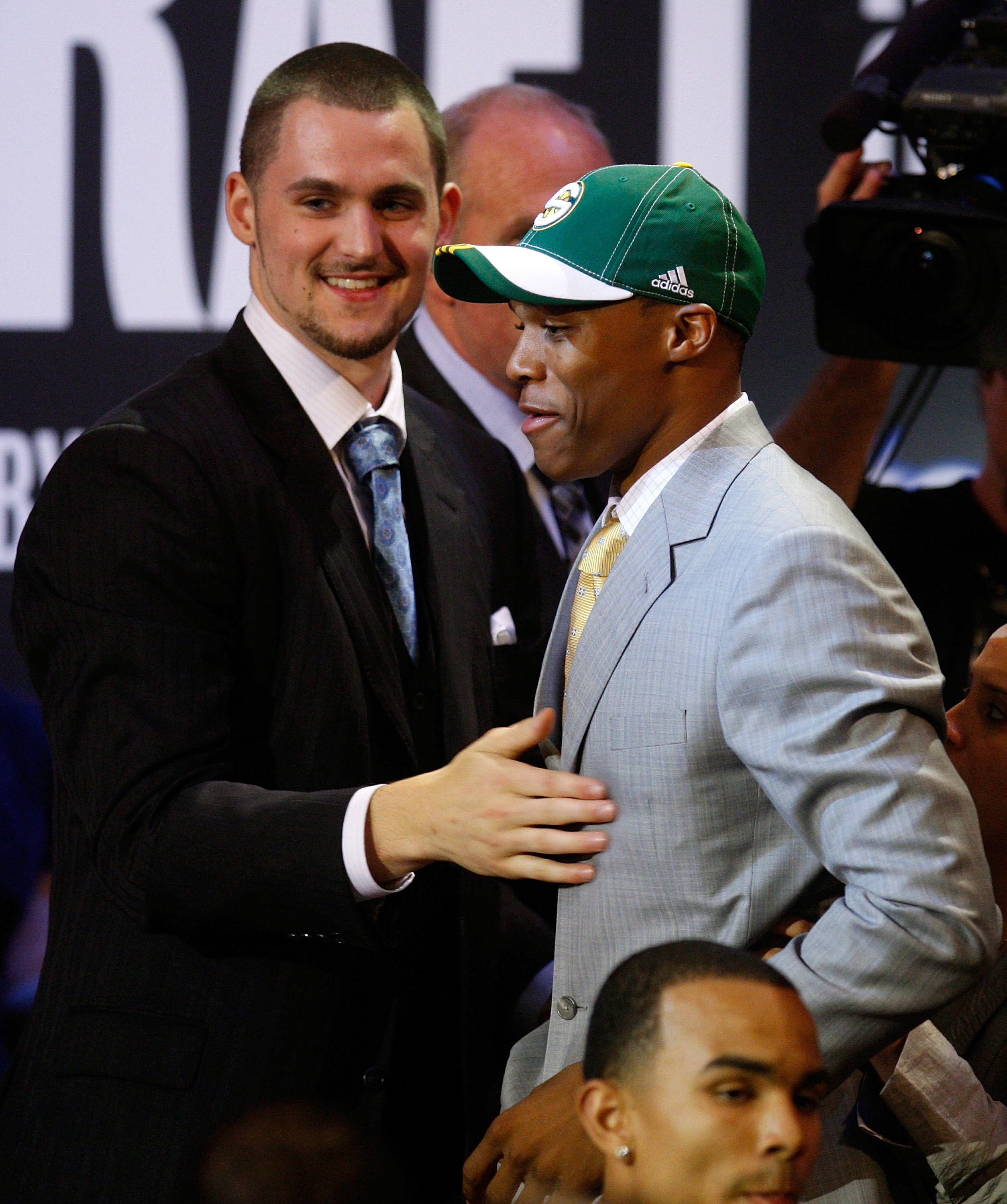NEW YORK - JUNE 26:  (R-L) Number four draft pick for the Seattle SuperSonics, Russell Westbrook is congratulated by the fifth pick for the Memphis Grizzlies, Kevin Love during the 2008 NBA Draft at the Wamu Theatre at Madison Square Garden June 26, 2008