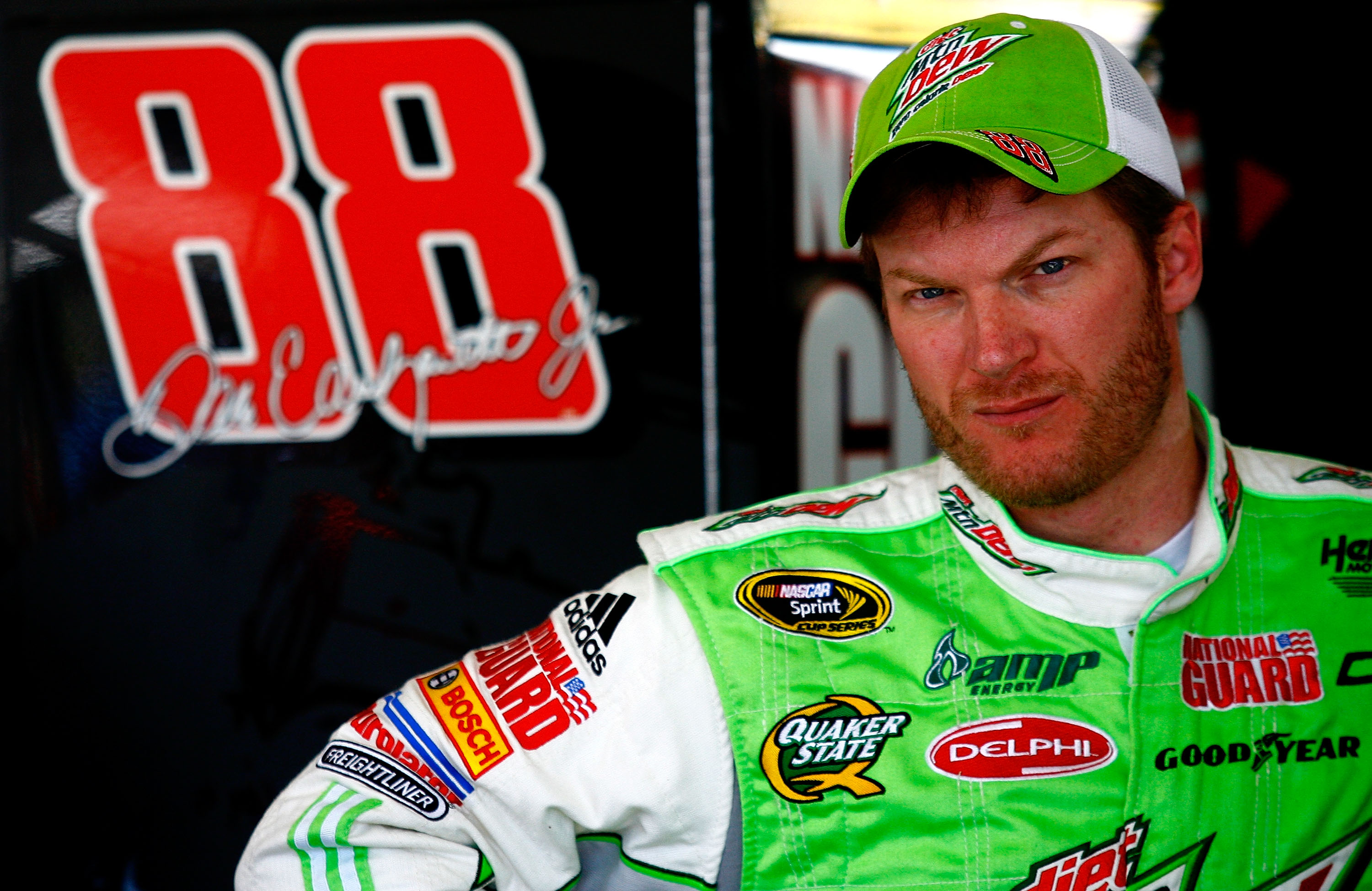 AVONDALE, AZ - NOVEMBER 13:  Dale Earnhardt Jr., driver of the #88 Diet Mountain Dew Chevrolet, stands in the garage area during practice for the NASCAR Sprint Cup Series Kobalt Tools 500 at Phoenix International Raceway on November 13, 2010 in Avondale,