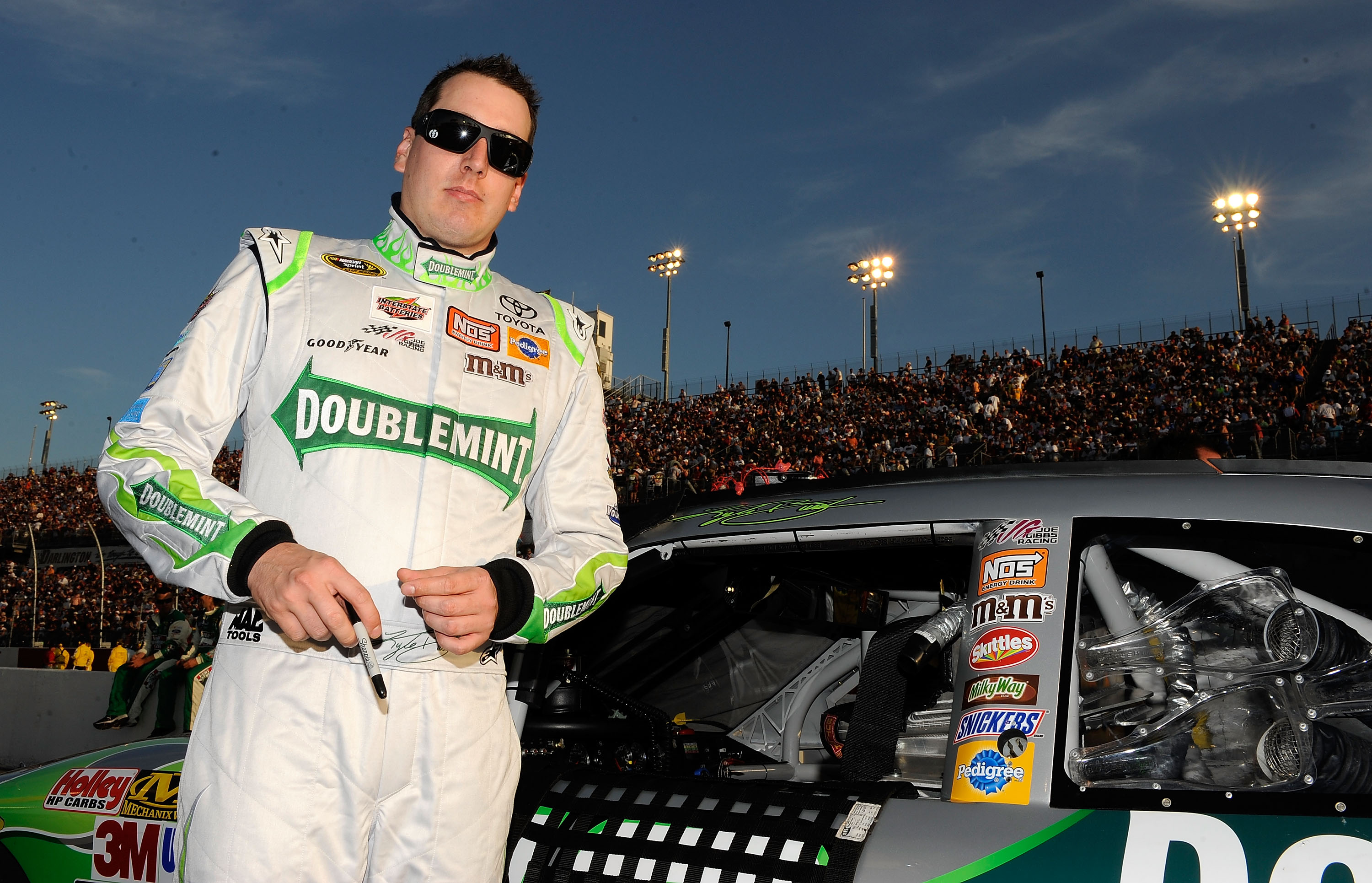 DARLINGTON, SC - MAY 08:  Kyle Busch, driver of the #18 Doublemint Toyota, stands on the grid prior to the start of the NASCAR Sprint Cup series SHOWTIME Southern 500 at Darlington Raceway on May 8, 2010 in Darlington, South Carolina.  (Photo by Rusty Jar