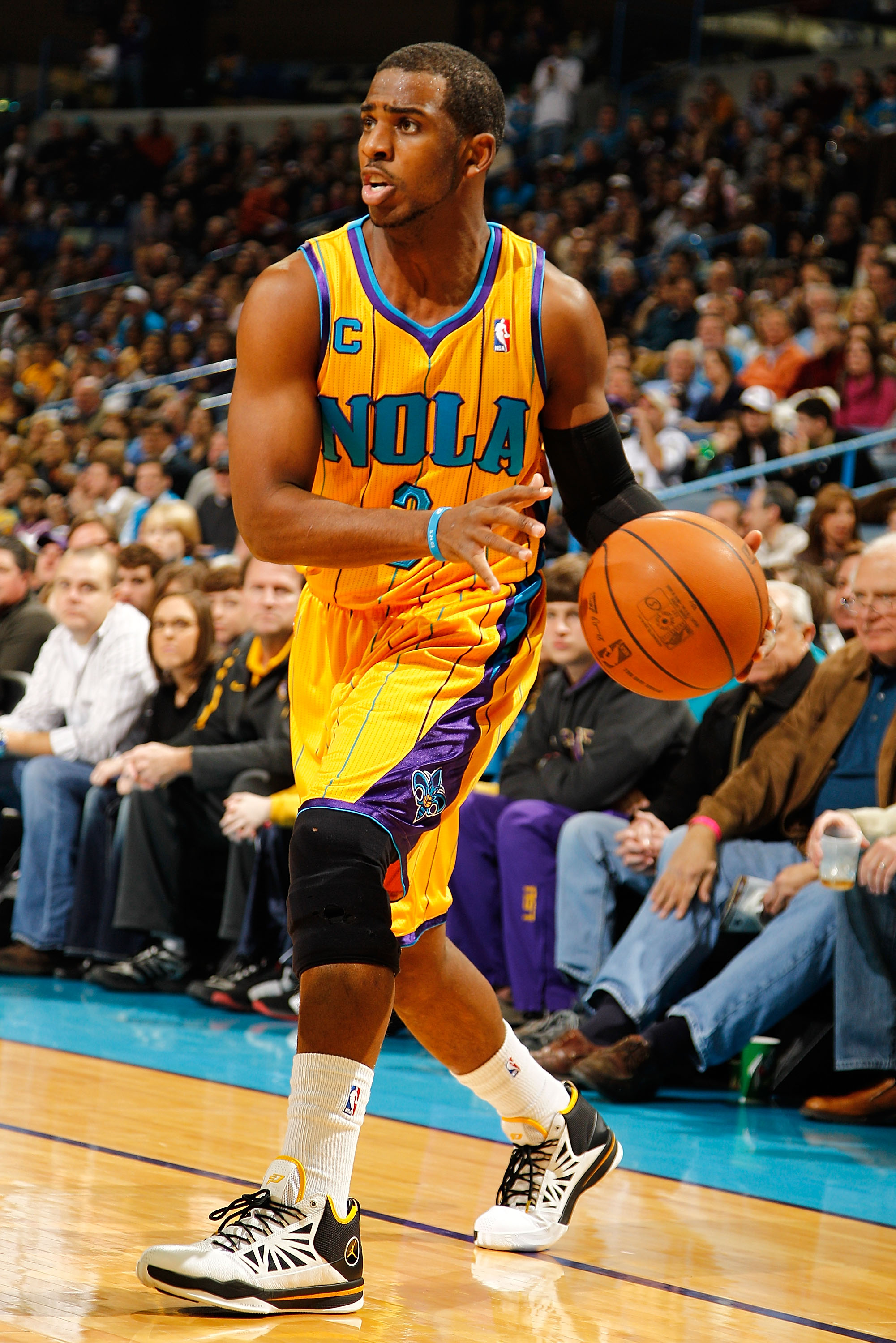 NEW ORLEANS, LA - JANUARY 22:  Chris Paul #3 of the New Orleans Hornets looks to pass the ball during the game against the San Antonio Spurs at the New Orleans Arena on January 22, 2011 in New Orleans, Louisiana.  The Hornets defeated the Spurs 96-72.  NO