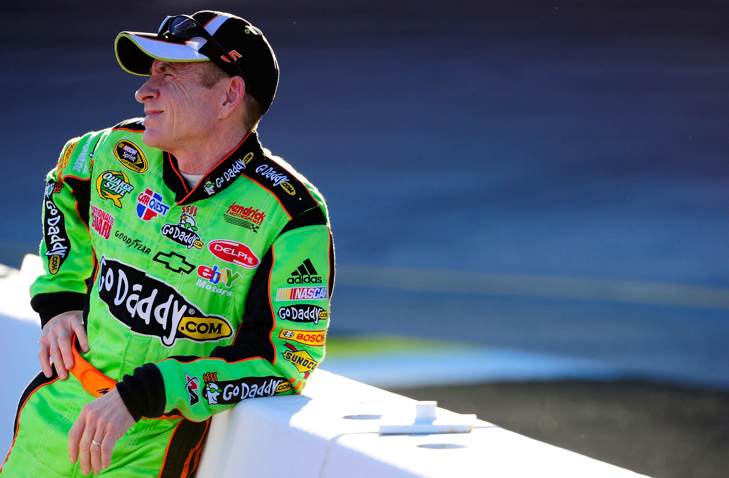 AVONDALE, AZ - NOVEMBER 12:  Mark Martin, driver of the #5 GoDaddy.com Chevrolet, stands on pit road during qualifying for the NASCAR Sprint Cup Series Kobalt Tools 500 at Phoenix International Raceway on November 12, 2010 in Avondale, Arizona.  (Photo by