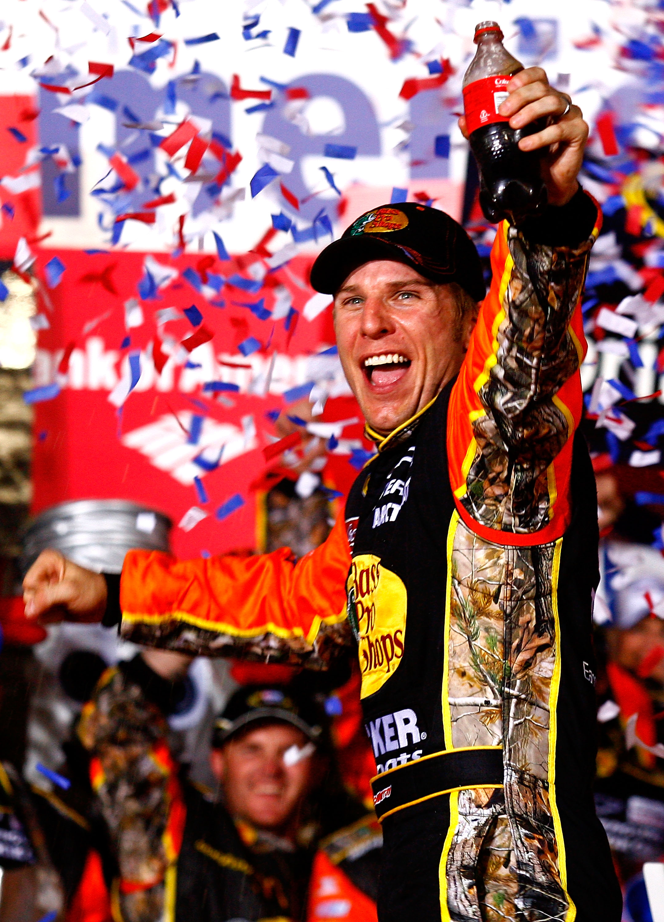 CONCORD, NC - OCTOBER 16:  Jamie McMurray, driver of the #1 Bass Pro Shops/Tracker Boats Chevrolet, celebrates in Victory Lane after winning the NASCAR Sprint Cup Series Bank of America 500 at Charlotte Motor Speedway on October 16, 2010 in Concord, North