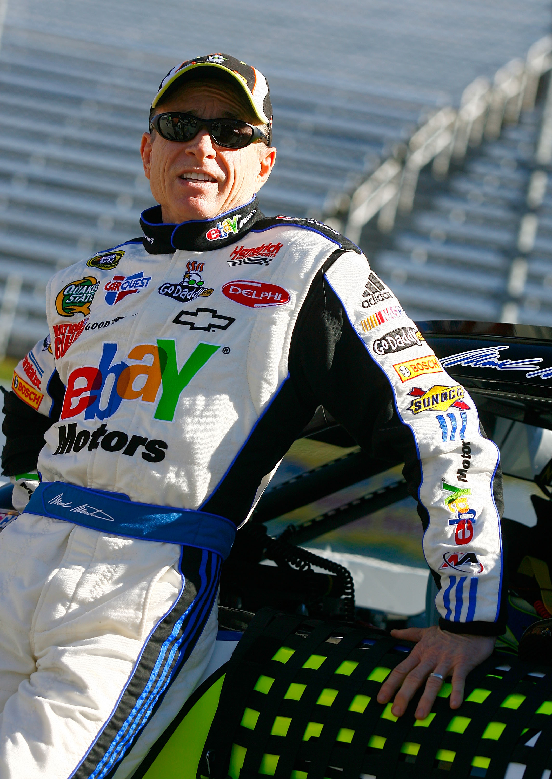 MARTINSVILLE, VA - OCTOBER 22:  Mark Martin, driver of the #5 ebay Motors/GoDaddy.com Chevrolet, stands next to his car on pit road during qualifying for the NASCAR Sprint Cup Series TUMS Fast Relief 500 at Martinsville Speedway on October 22, 2010 in Mar
