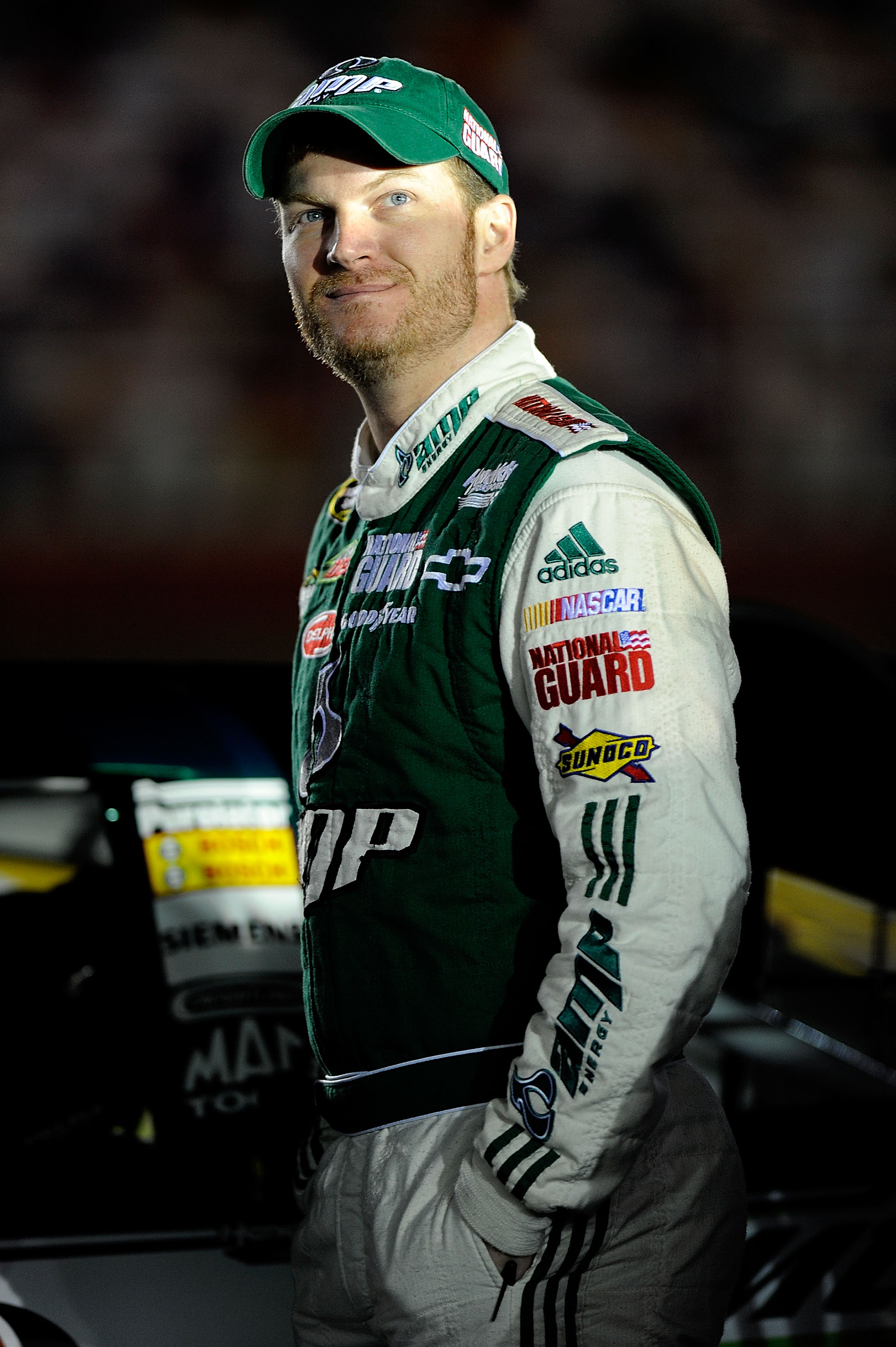 CONCORD, NC - OCTOBER 14:  Dale Earnhardt Jr., drivere of the #88 AMP Energy/Natgional Guard Chevrolet, stands on pit road during qualifying for the NASCAR Sprint Cup Series Bank of America 500 at Charlotte Motor Speedway on October 14, 2010 in Concord, N