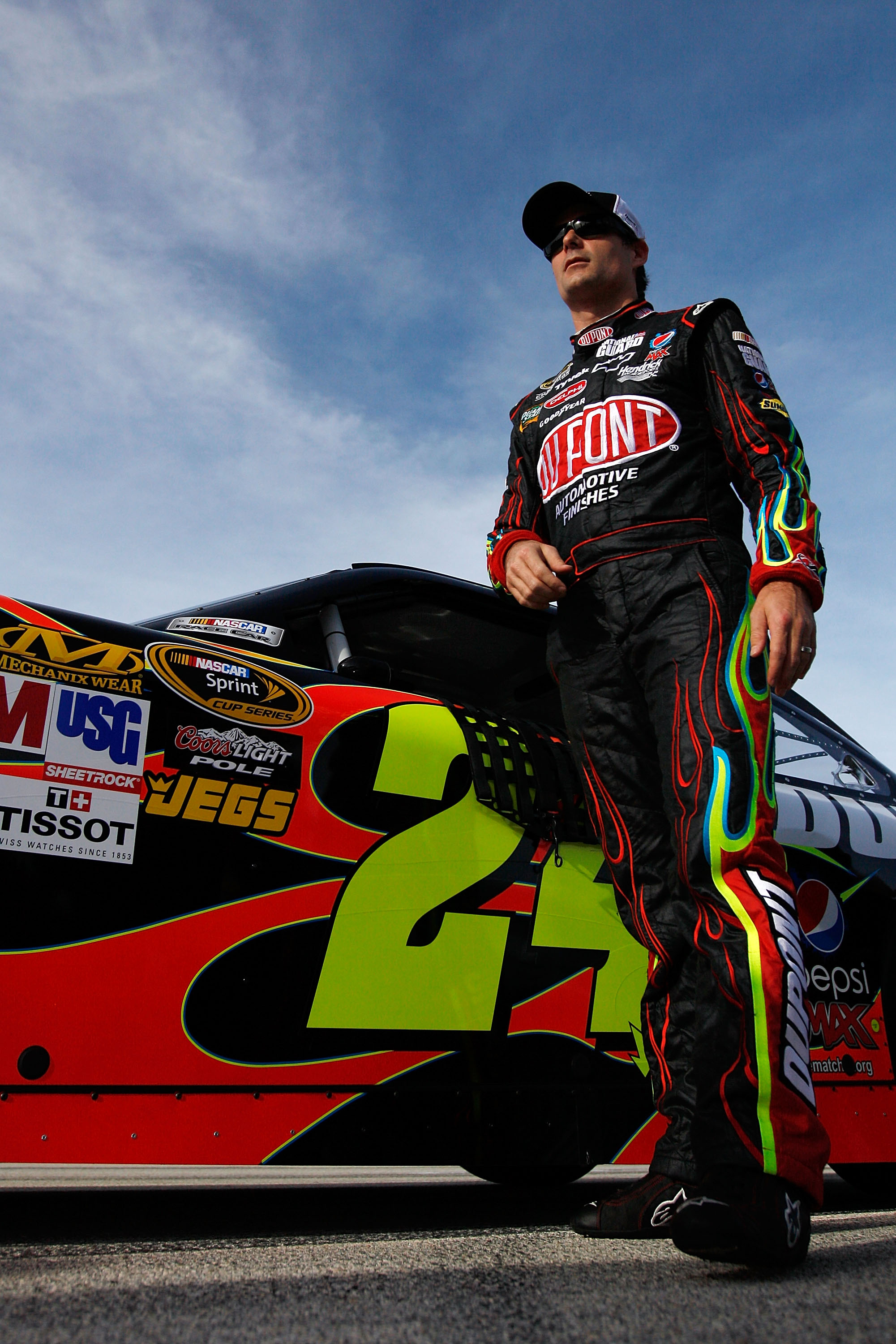 HOMESTEAD, FL - NOVEMBER 19:  Jeff Gordon, driver of the #24 DuPont Chevrolet, stands by his car after qualifying for the NASCAR Sprint Cup Series Ford 400 at Homestead-Miami Speedway on November 19, 2010 in Homestead, Florida.  (Photo by Chris Graythen/G
