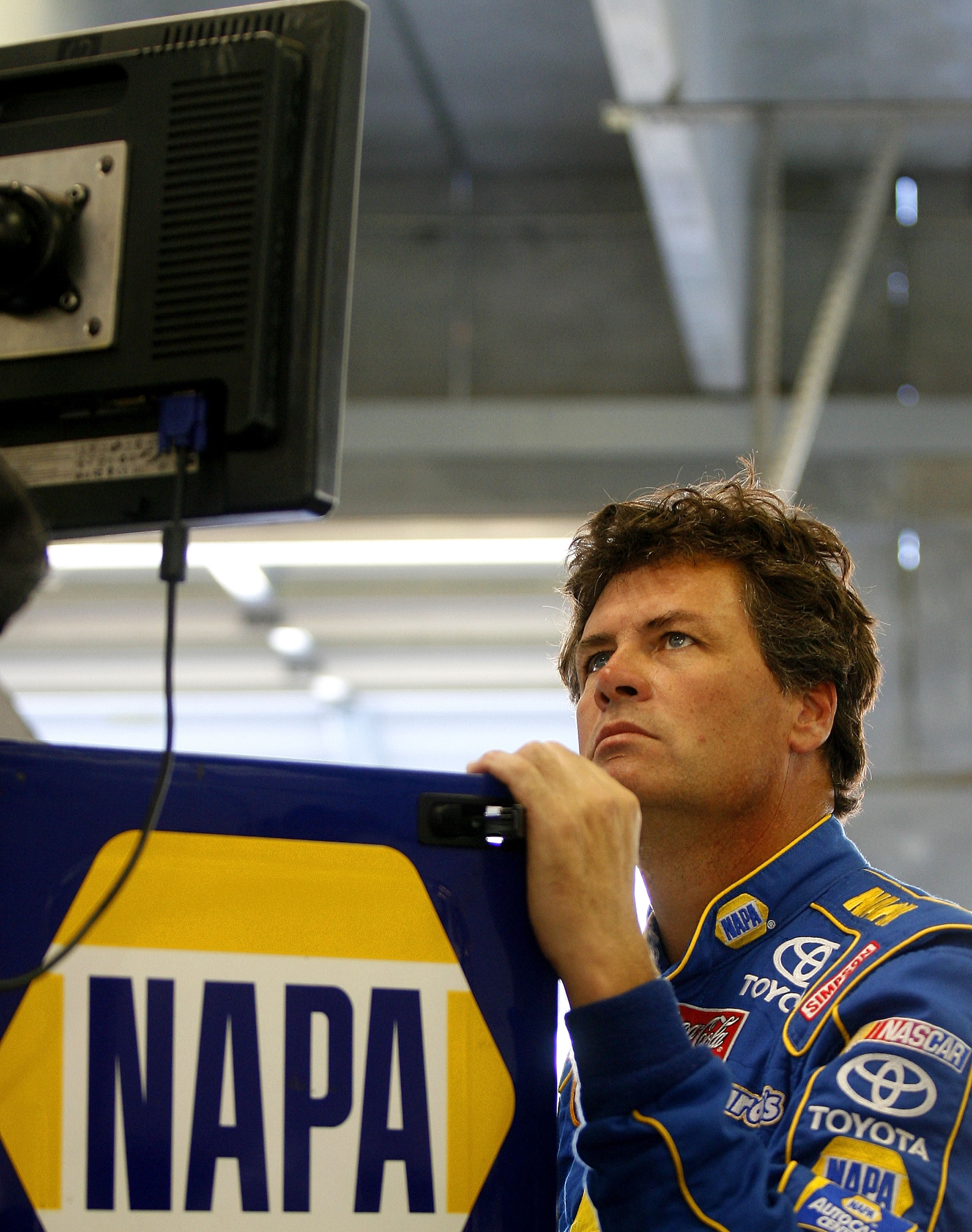 HAMPTON, GA - OCTOBER 25:  Michael Waltrip, driver of the #55 NAPA Auto Parts Toyota, views the scoring monitor during practice for the NASCAR Sprint Cup Series Pep Boys Auto 500 at Atlanta Motor Speedway on October 25, 2008 in Hampton, Georgia.  (Photo b