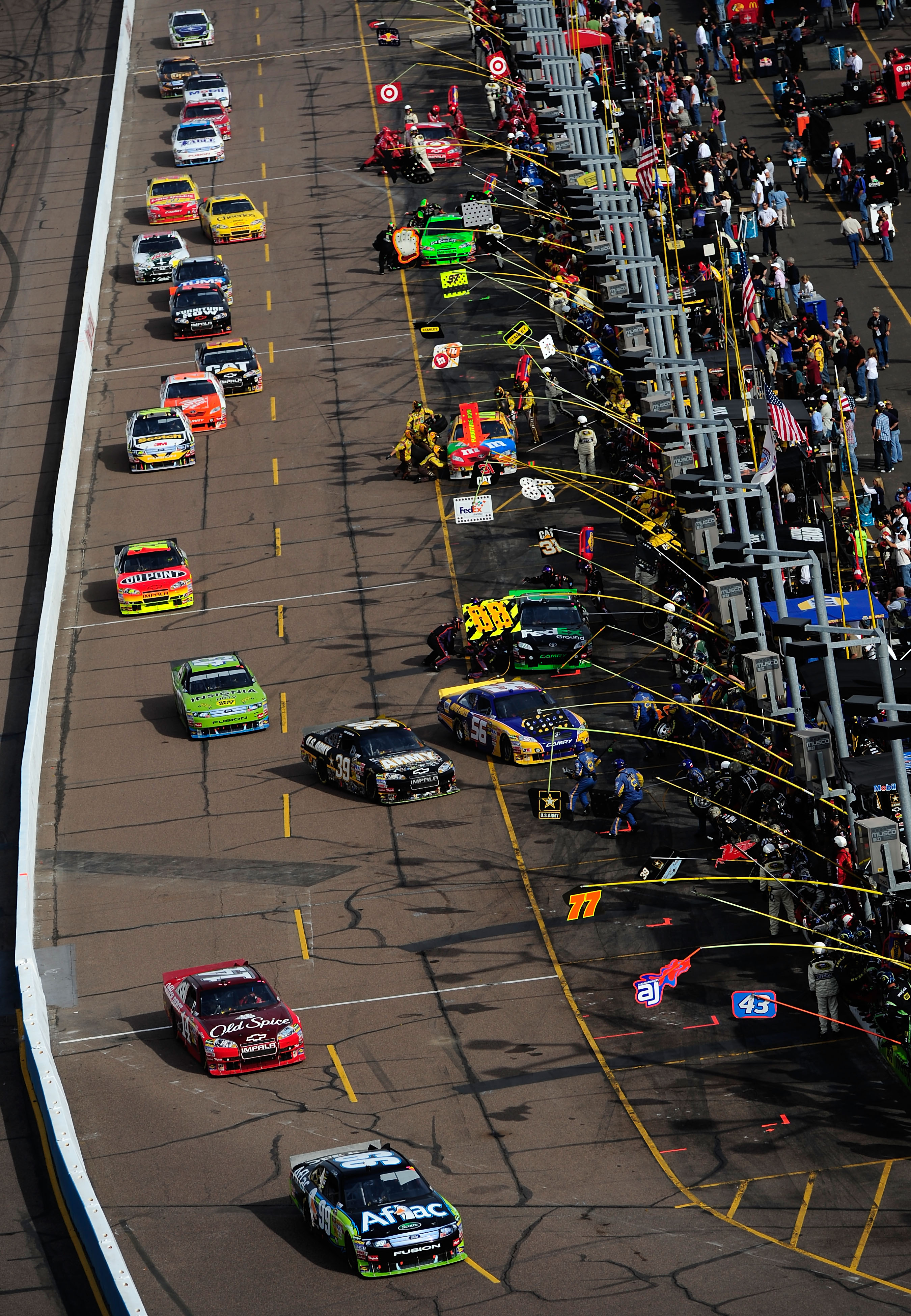 AVONDALE, AZ - NOVEMBER 14:  Carl Edwards, driver of the #99 Aflac Ford, leads cars off of pit road during the NASCAR Sprint Cup Series Kobalt Tools 500 at Phoenix International Raceway on November 14, 2010 in Avondale, Arizona.  (Photo by Robert Laberge/