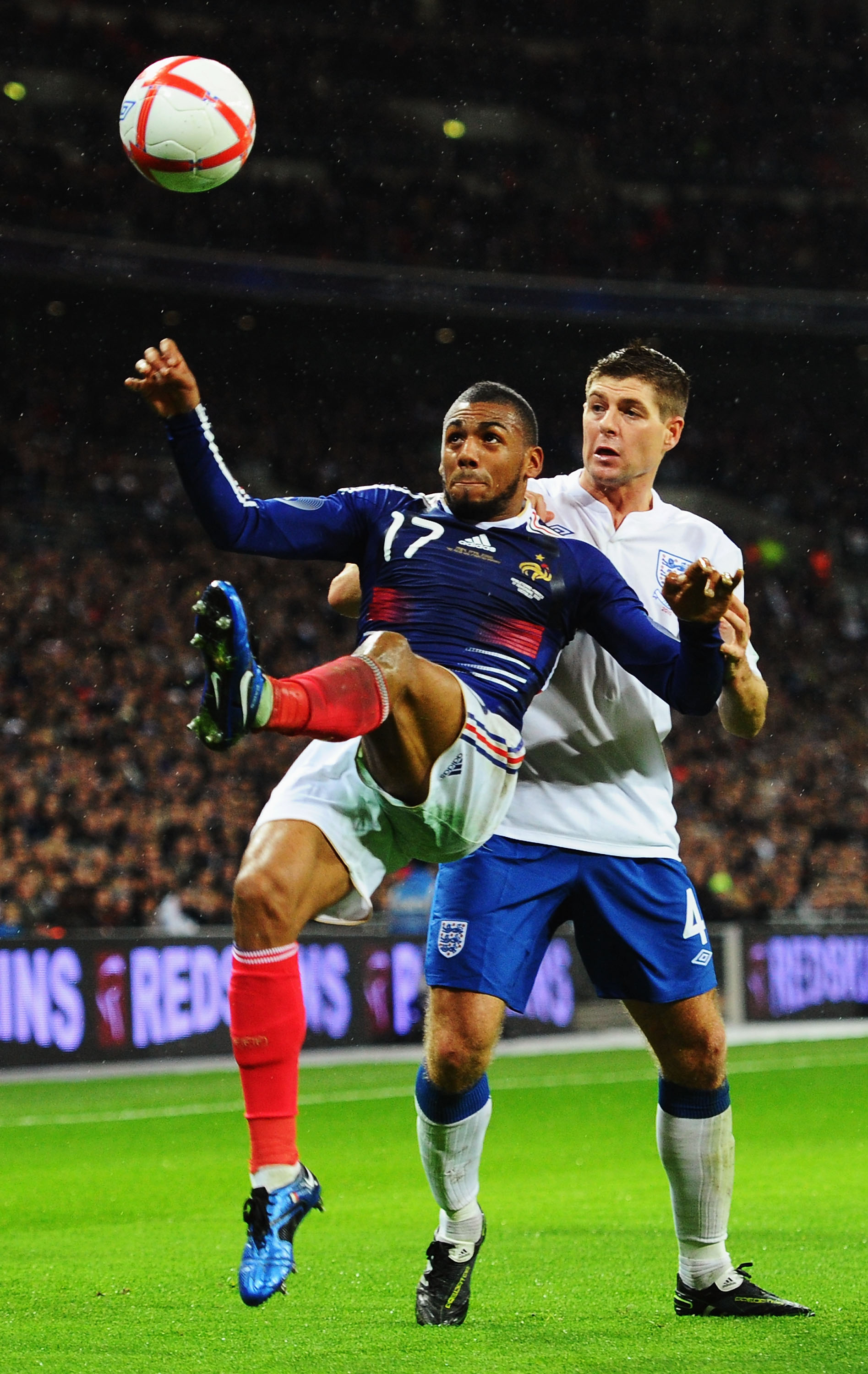 LONDON, ENGLAND - NOVEMBER 17:  Steven Gerrard of England is beaten to the ball by Yann M'Vila of France during the international friendly match between England and France at Wembley Stadium on November 17, 2010 in London, England.  (Photo by Mike Hewitt/
