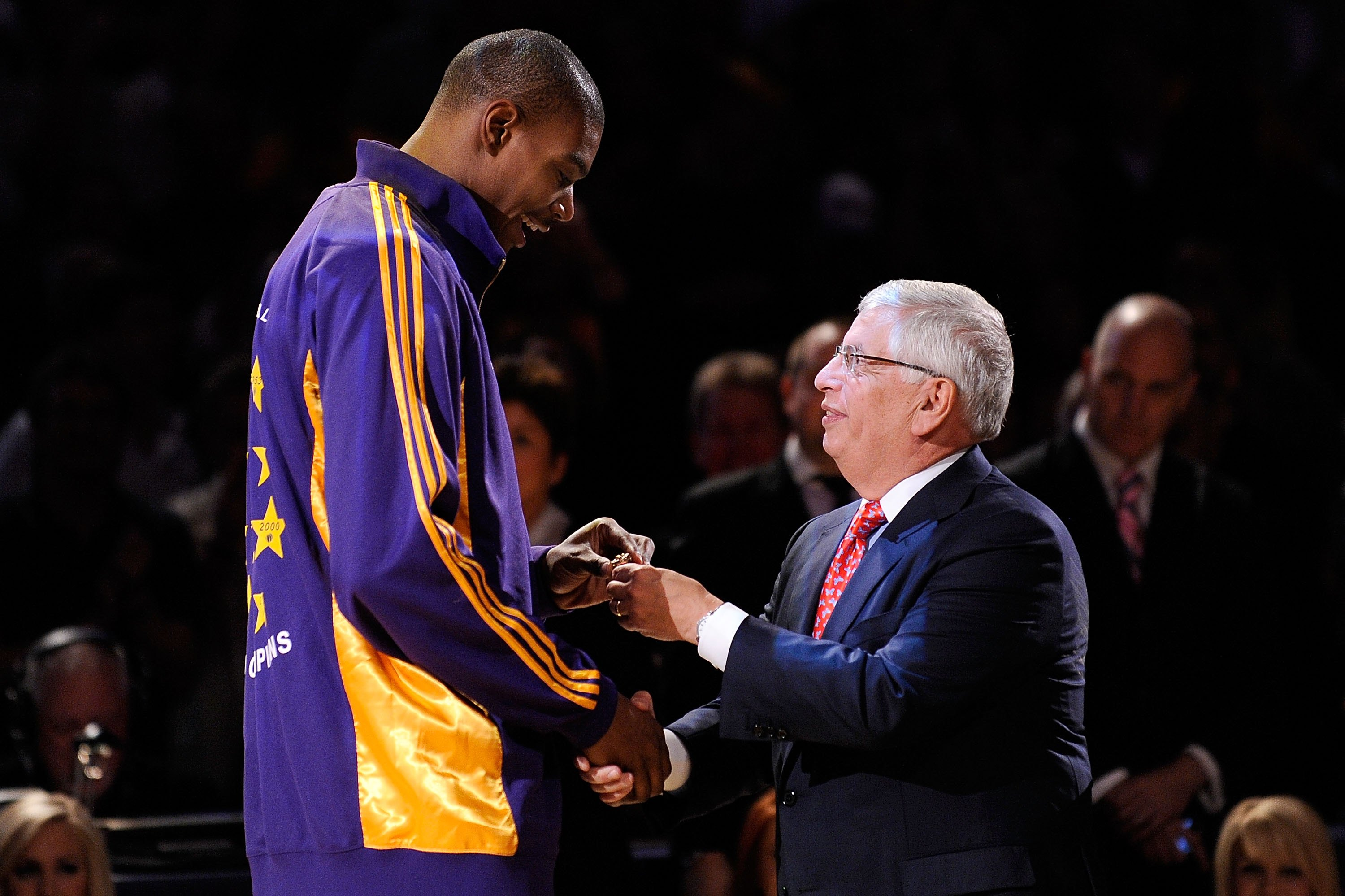LOS ANGELES, CA - OCTOBER 27:  Andrew Bynum #17 of the Los Angeles Lakers receives his 2009 NBA Championship ring from NBA Commissioner David Stern before the season opening game against the Los Angeles Clippers at Staples Center on October 27, 2009 in Lo