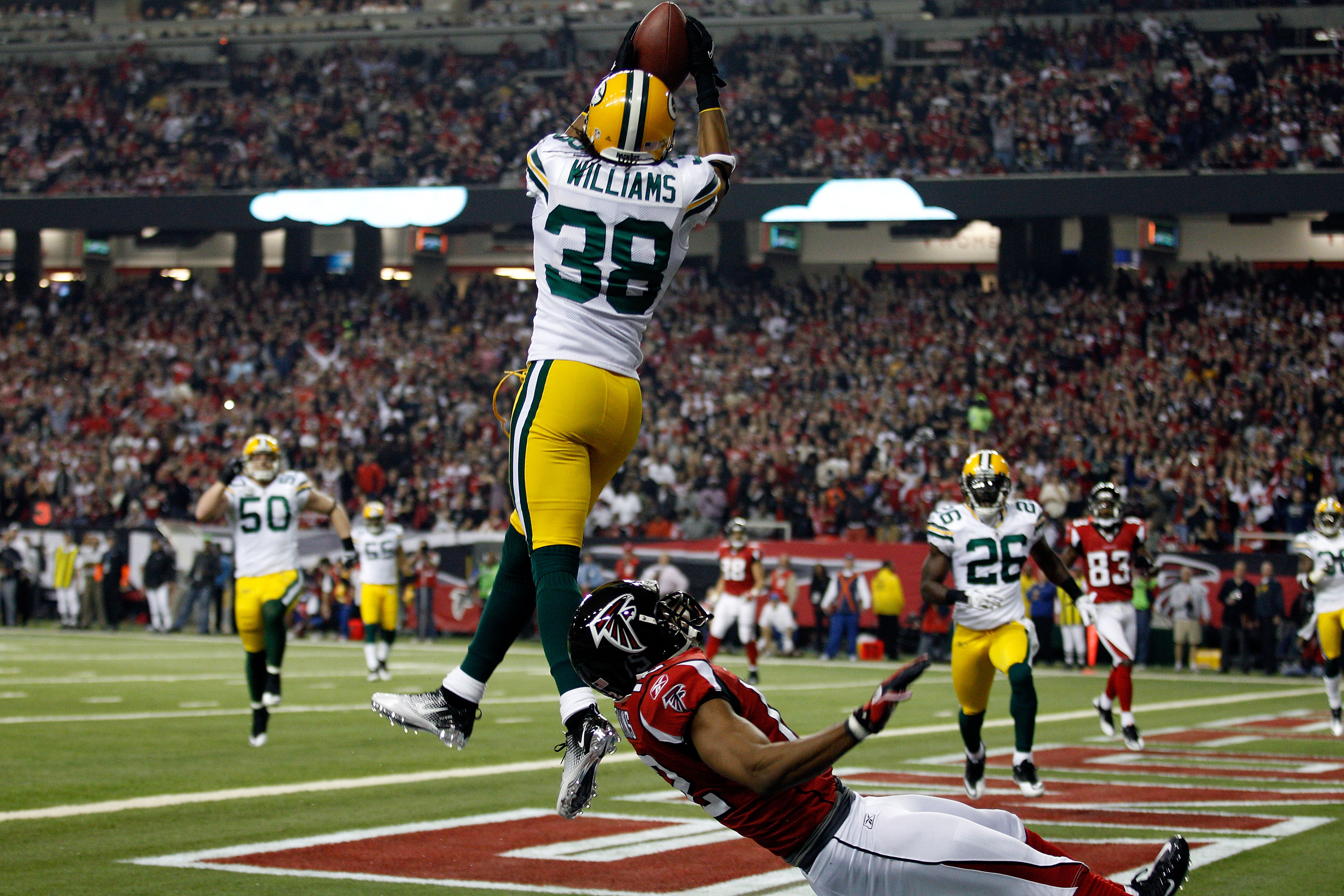 ATLANTA, GA - JANUARY 15:  Tramon Williams #38 of the Green Bay Packers intercepts a pass in the endzone against Michael Jenkins #12 of the Atlanta Falcons during their 2011 NFC divisional playoff game at Georgia Dome on January 15, 2011 in Atlanta, Georg