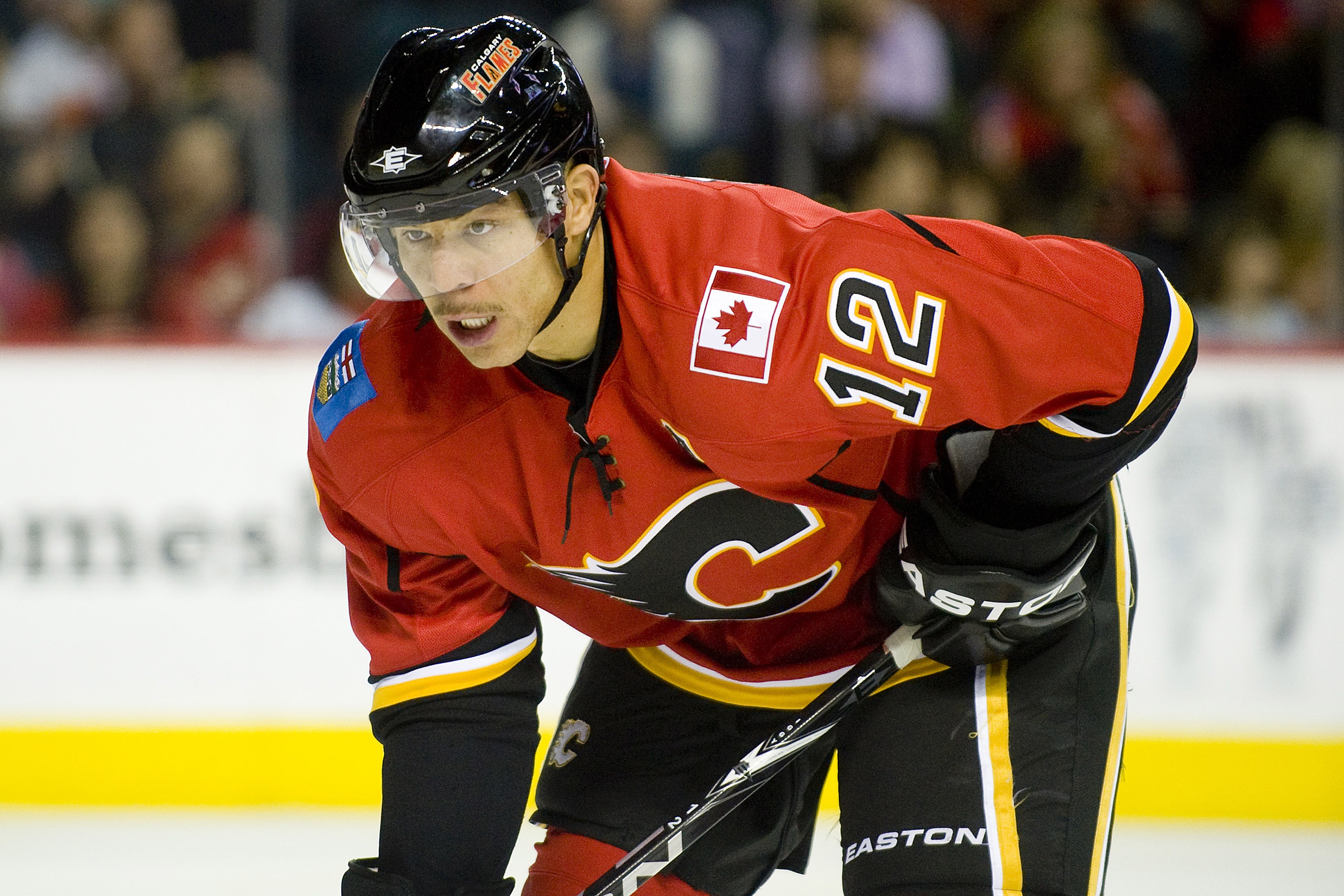 EDMONTON, AB - NOVEMBER 29:  Jarome Iginla #12 of the Calgary Flames concentrates on the puck during a game against the Minnesota Wild at Scotiabank Saddledome on November 29, 2010 in Calgary, Alberta, Canada. The Flames beat the Wild 3-0.  (Photo by Dyla