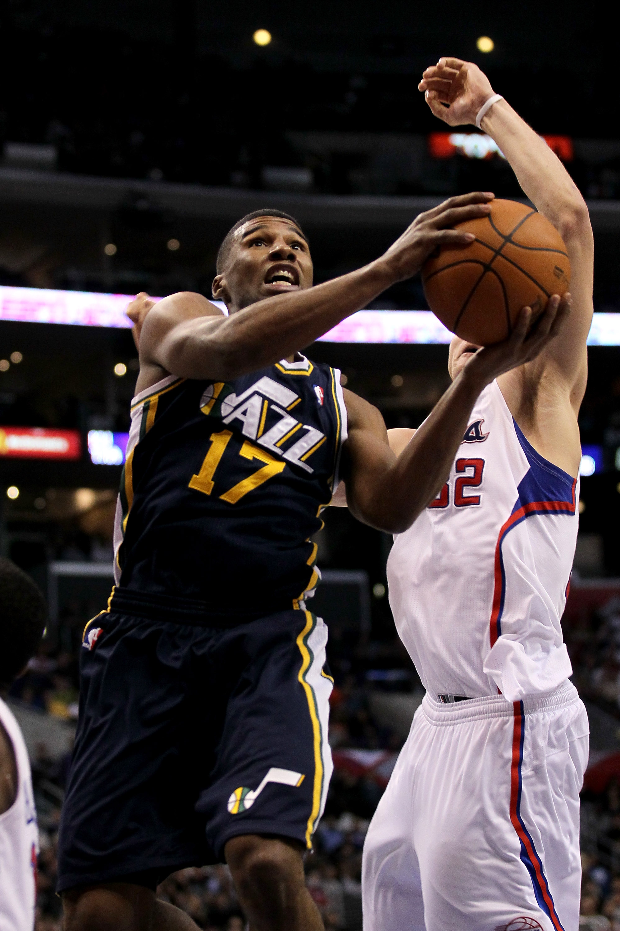 LOS ANGELES, CA - DECEMBER 29:  Ronnie Price #17 of the Utah Jazz shoots over Blake Griffin #32 of the Los Angeles Clippers at Staples Center on December 29, 2010 in Los Angeles, California.   The Jazz won 103-85.  NOTE TO USER: User expressly acknowledge