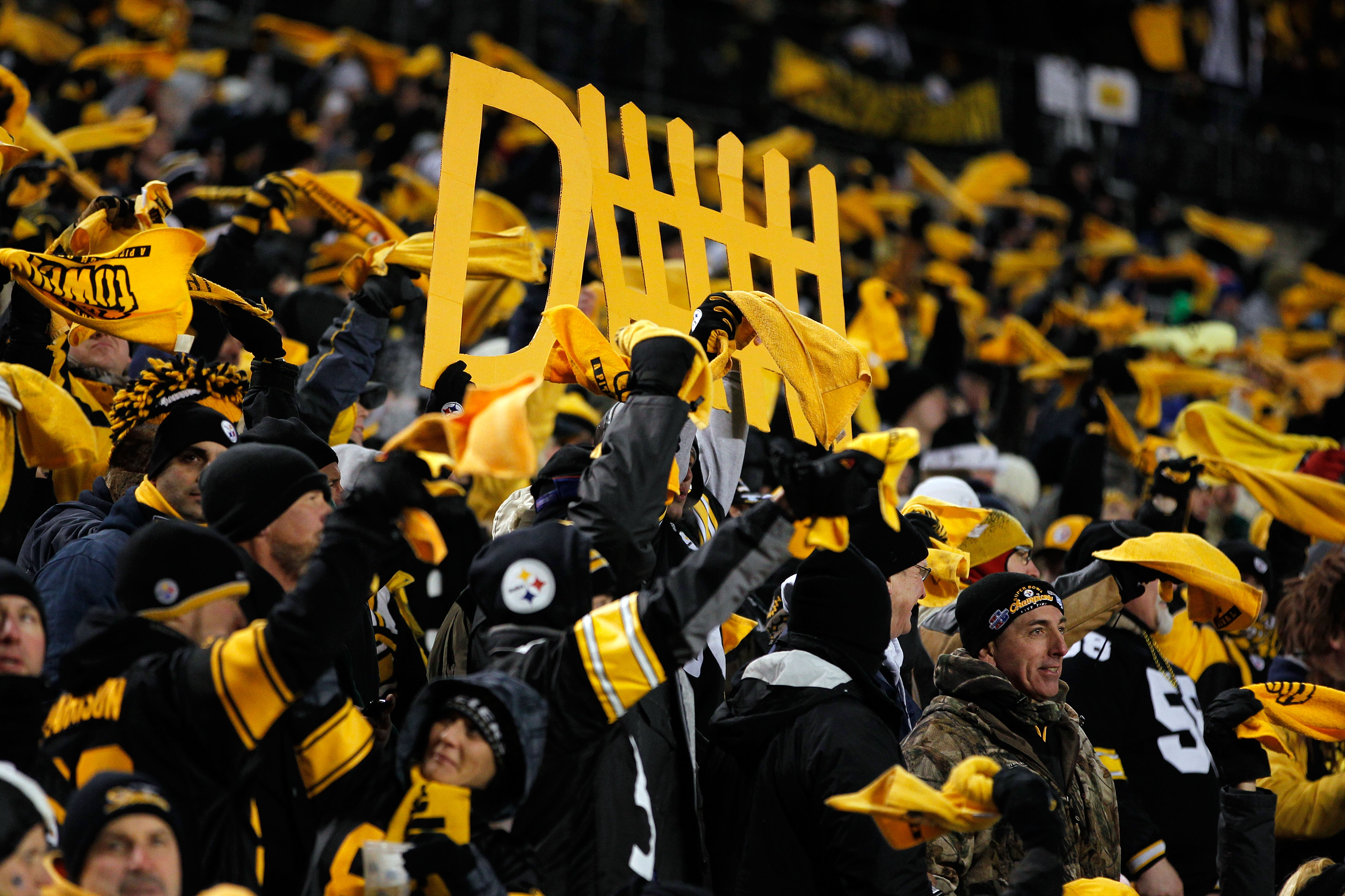 PITTSBURGH, PA - JANUARY 23:  Pittsburgh Steelers fans cheer during their 2011 AFC Championship game against the New York Jets at Heinz Field on January 23, 2011 in Pittsburgh, Pennsylvania.  (Photo by Gregory Shamus/Getty Images)