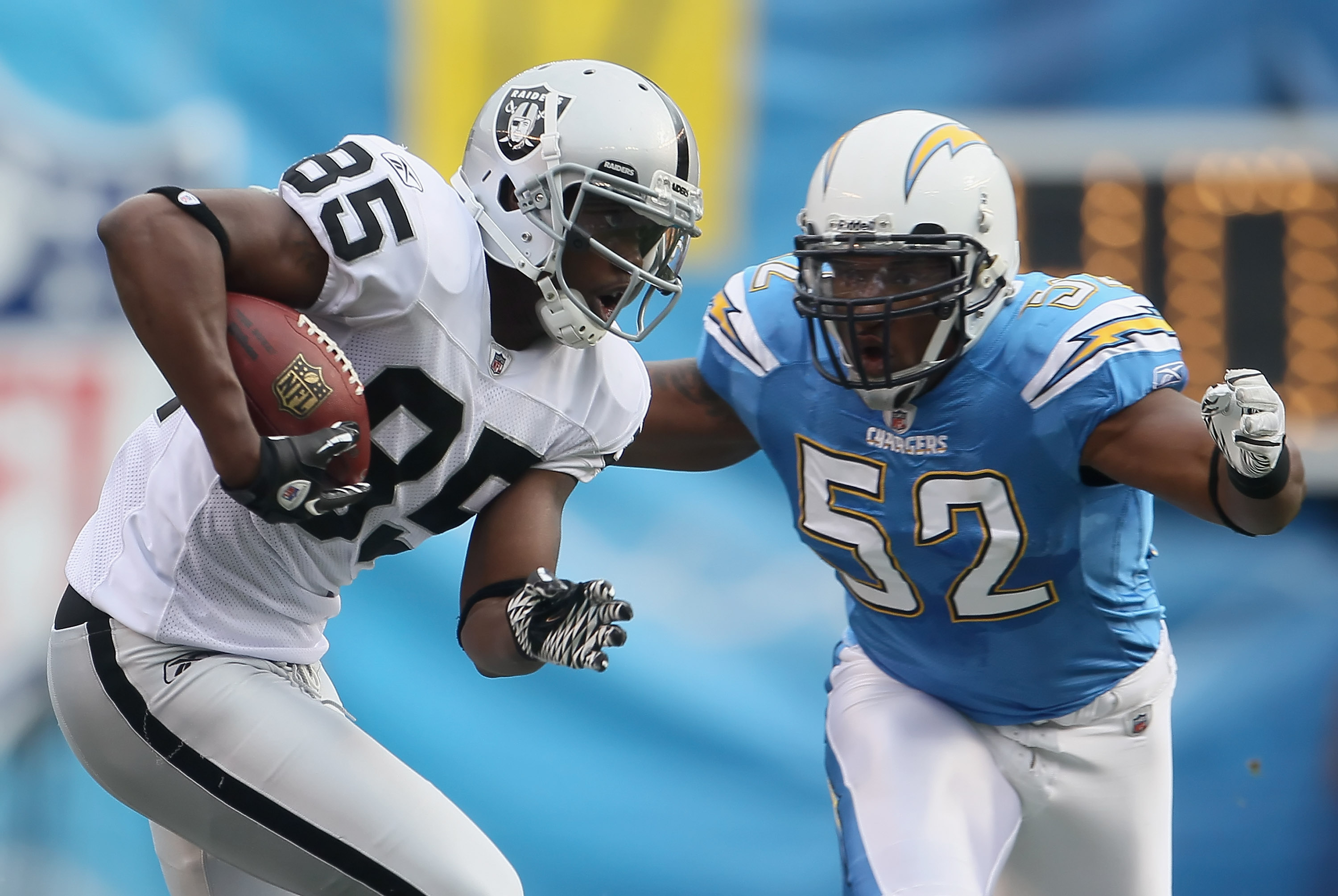 SAN DIEGO - DECEMBER 05:  Darrius Heyward-Bey #85 of the Oakland Raiders is pursued by Larry English #52 of the San Diego Chargers in the second quarter at Qualcomm Stadium on December 5, 2010 in San Diego, California. The Raiders defeated the Chargers 28