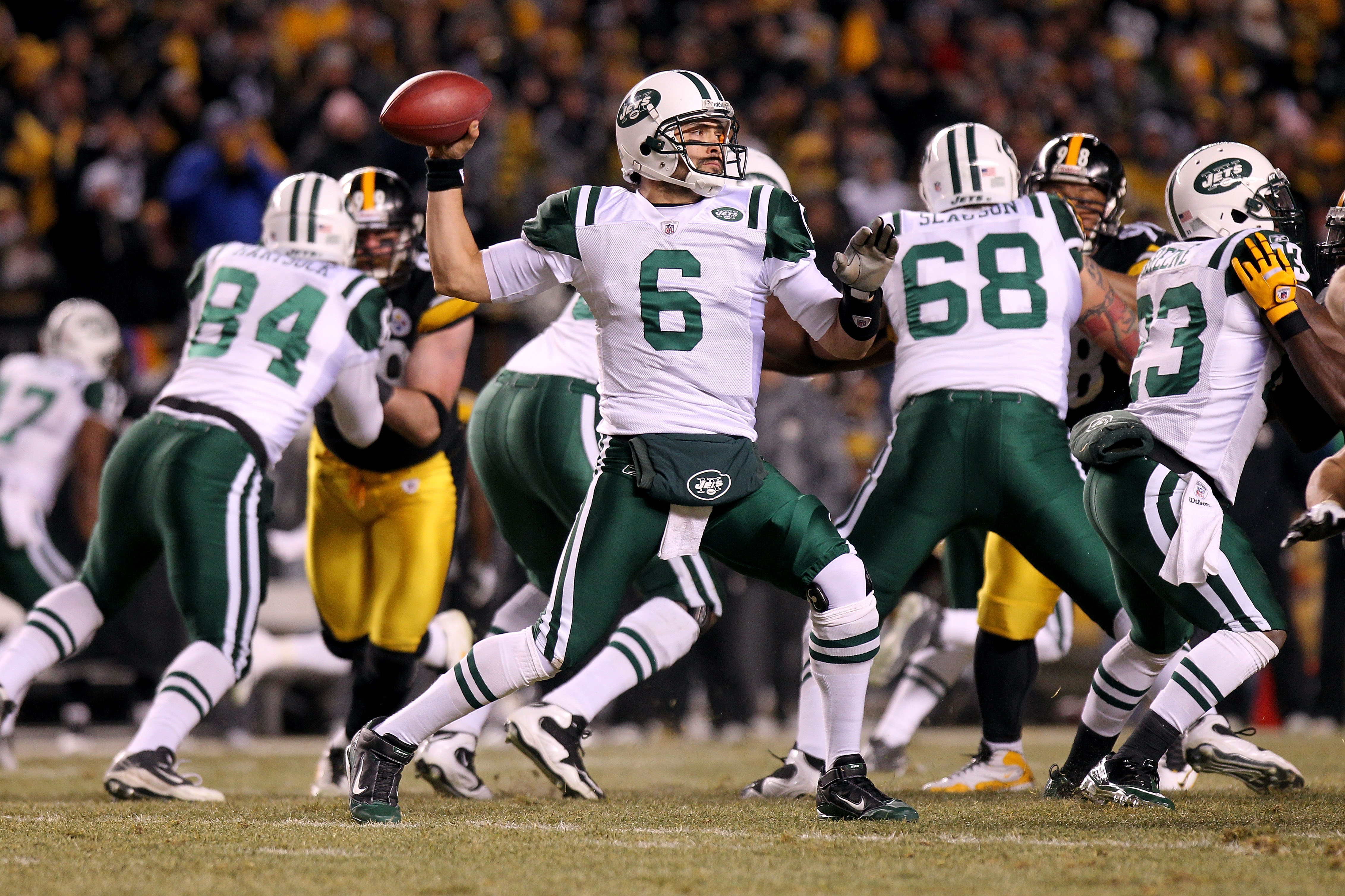 PITTSBURGH, PA - JANUARY 23:  Mark Sanchez #6 of the New York Jets drops back to pass against the Pittsburgh Steelers during the 2011 AFC Championship game at Heinz Field on January 23, 2011 in Pittsburgh, Pennsylvania.  (Photo by Nick Laham/Getty Images)