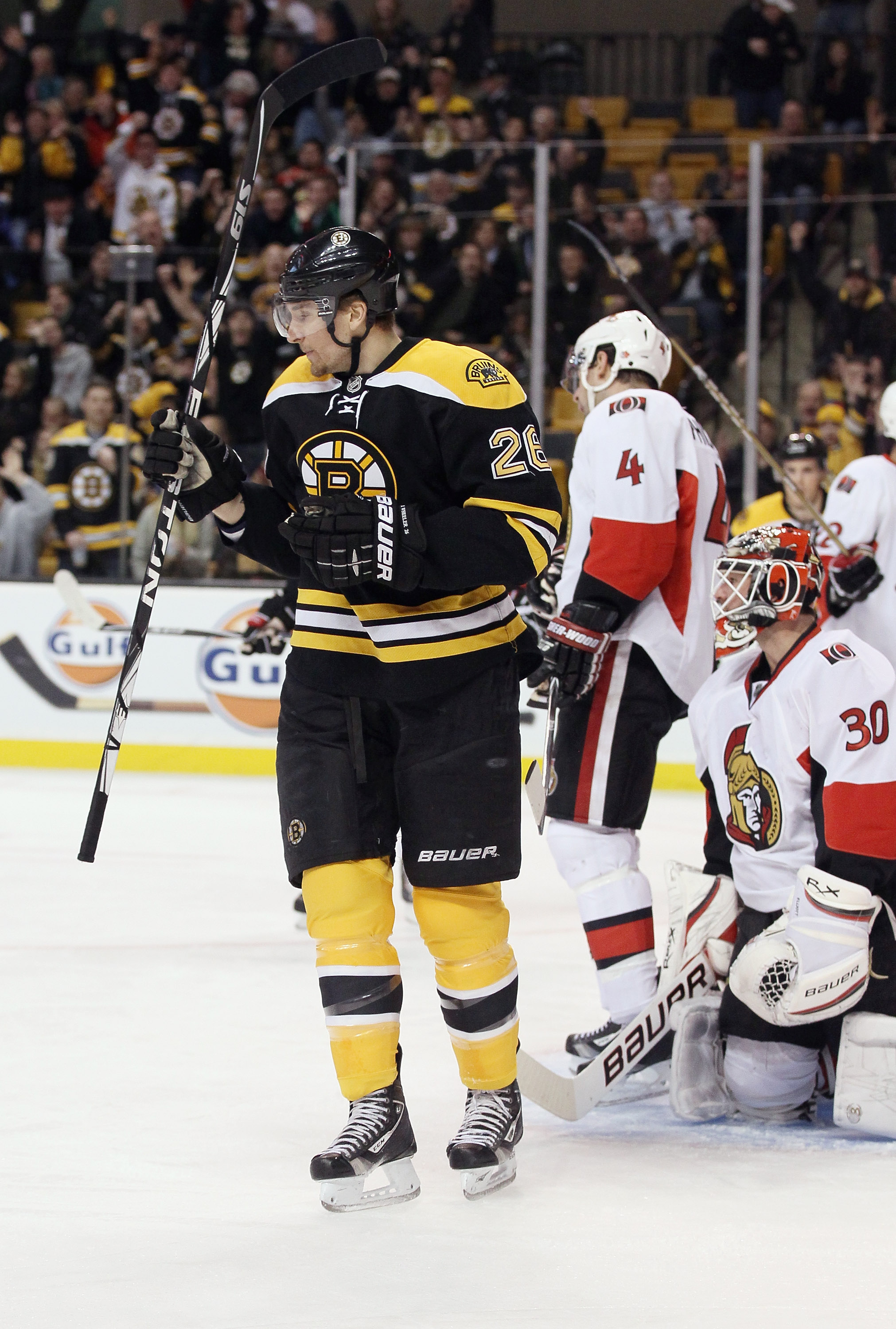 BOSTON, MA - JANUARY 11:  Blake Wheeler #26 of the Boston Bruins celebrates his goal as Brian Elliott #30 and Chris Phillips #4 of the Ottawa Senators stand by on January 11, 2011 at the TD Garden in Boston, Massachusetts.  (Photo by Elsa/Getty Images)