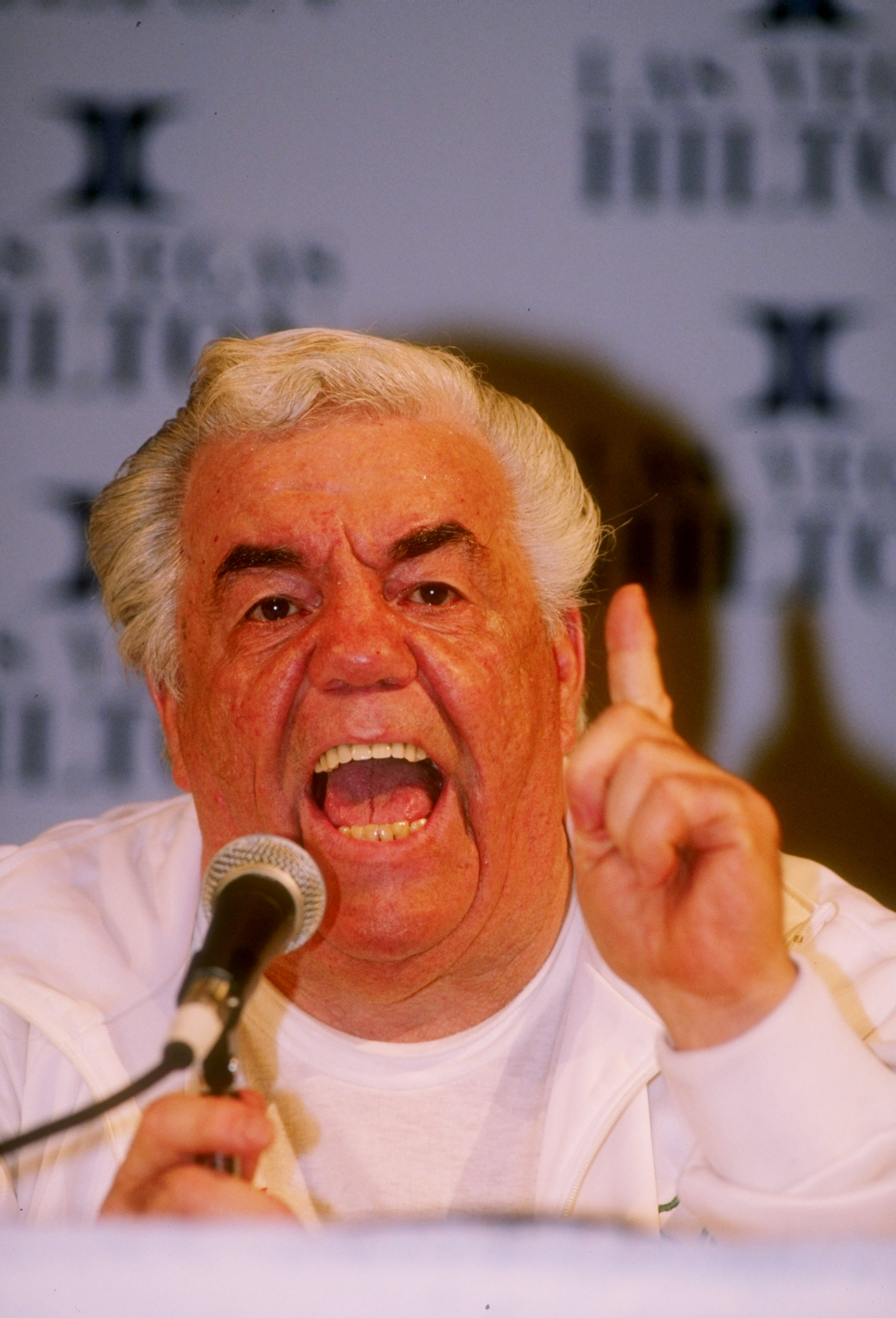 17 Mar 1990: Trainer Lou Duva shouts into a microphone during a press conference regarding his fighter Meldrick Taylor.