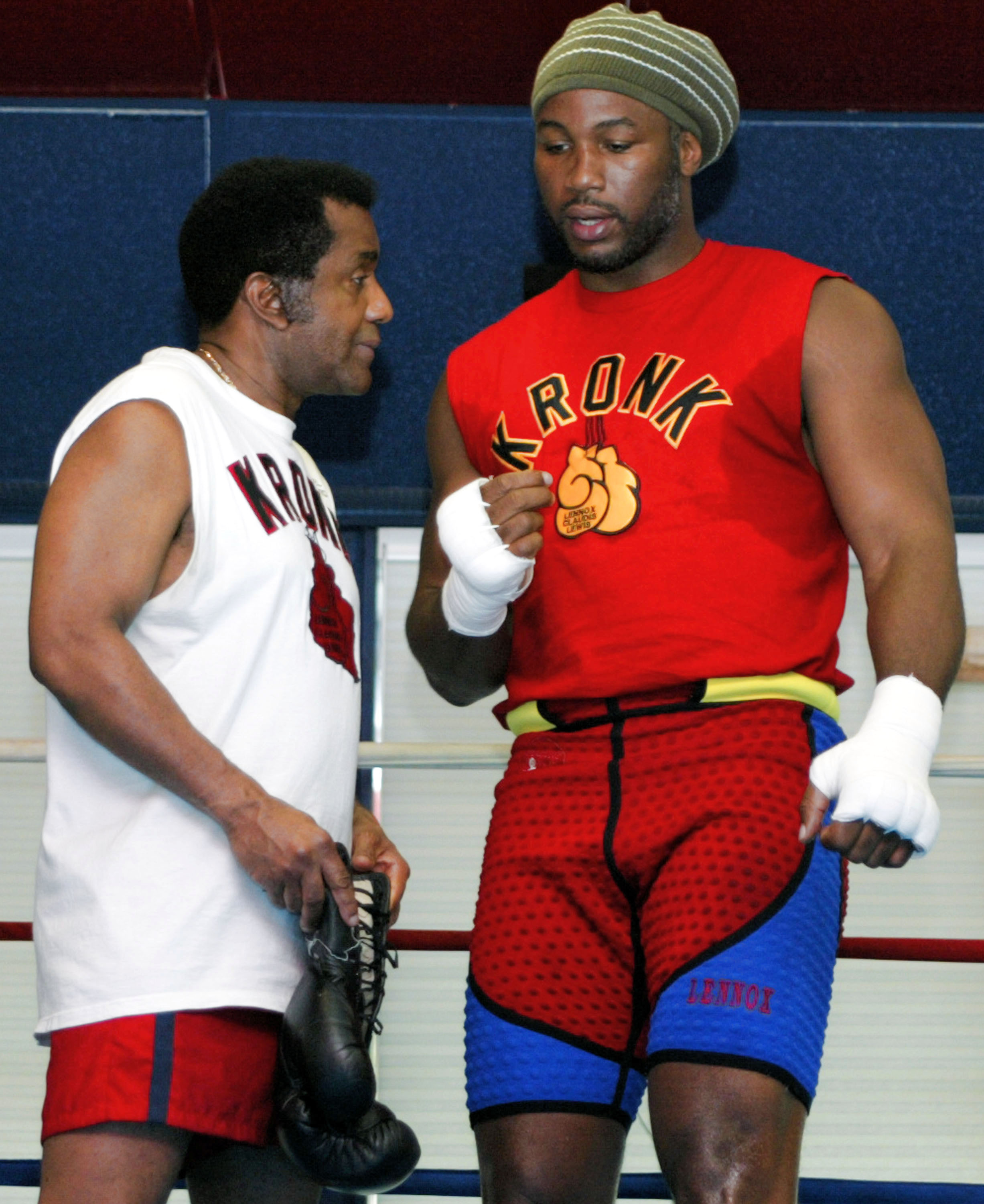 SCOTRUN, PA MAY 29:  Lennox Lewis (r) and his trainer Emanuel Steward (l) speak before a sparing session at his training camp on May 29, 2003 in Scotrun, Pennsylvania.  Lewis is training for is upcoming WBC title defense against Kirk Johnson on June 21, 2