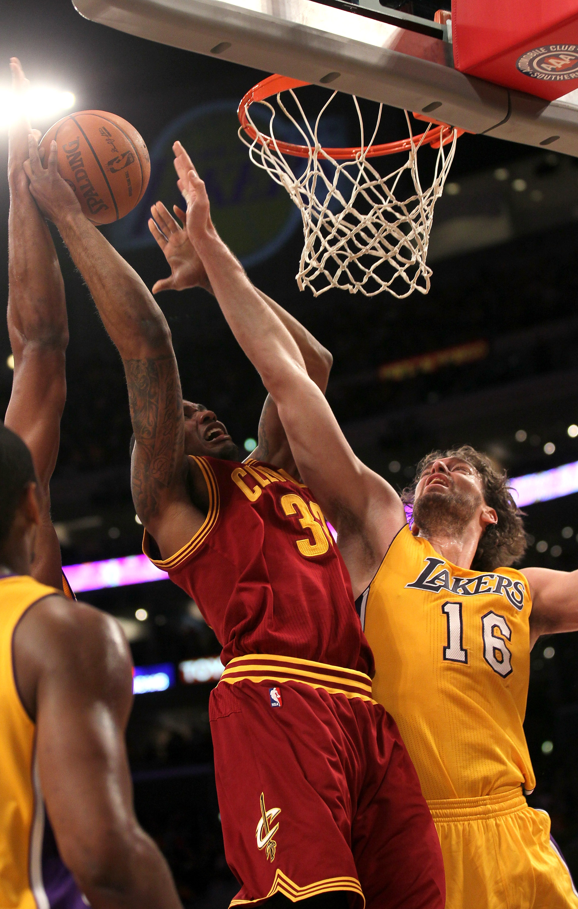 LOS ANGELES, CA - JANUARY 11:  Alonzo Gee #33 of  the Cleveland Cavaliers goes up to shoot against Pau Gasol #16 of the Los Angeles Lakers at Staples Center on January 11, 2011 in Los Angeles, California.  The Lakers won 112-57.  NOTE TO USER: User expres