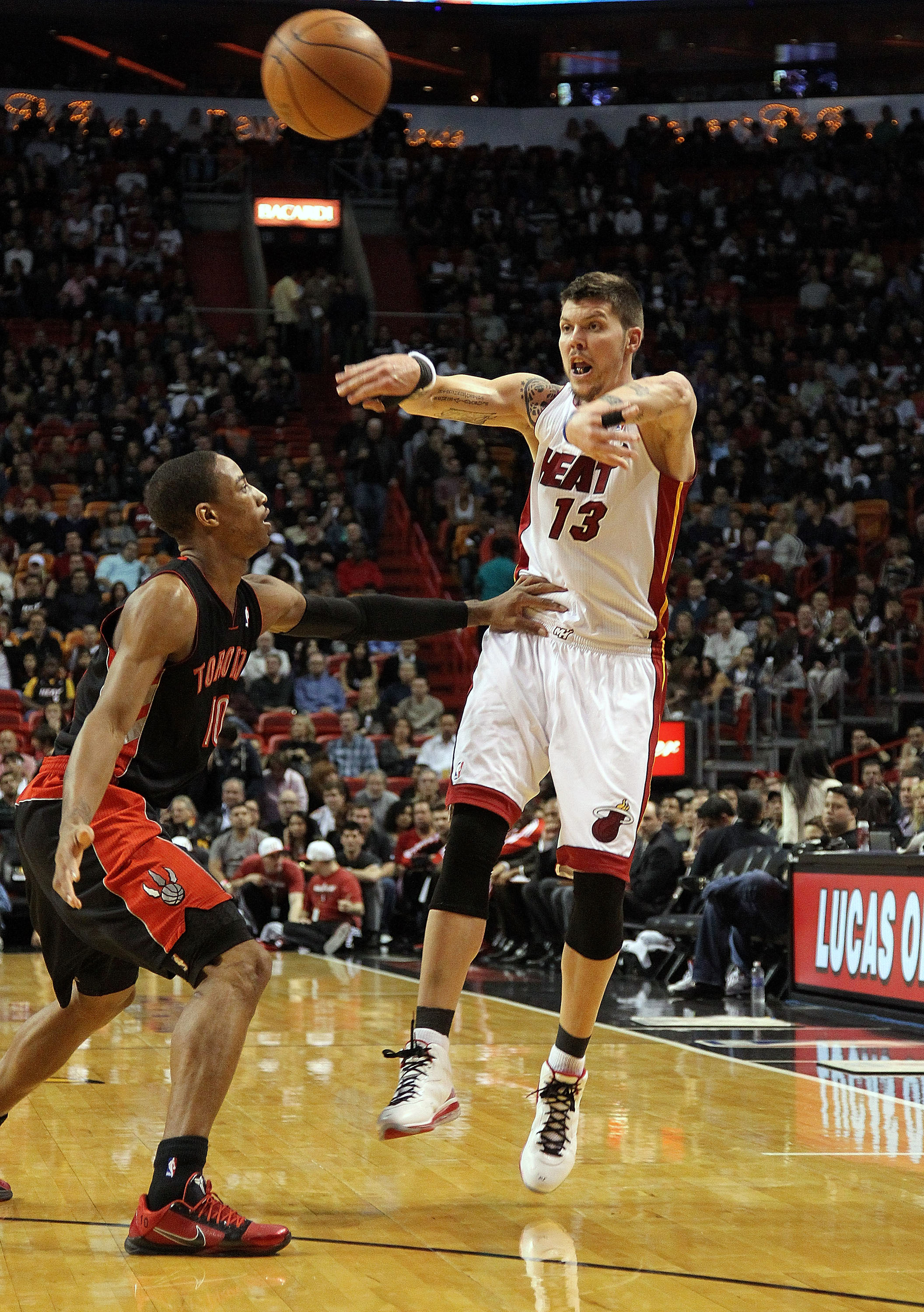 MIAMI, FL - JANUARY 22:  Mike Miller #13 of the Miami Heat spasses the ball during a game against the Toronto Raptors at American Airlines Arena on January 22, 2011 in Miami, Florida. NOTE TO USER: User expressly acknowledges and agrees that, by downloadi