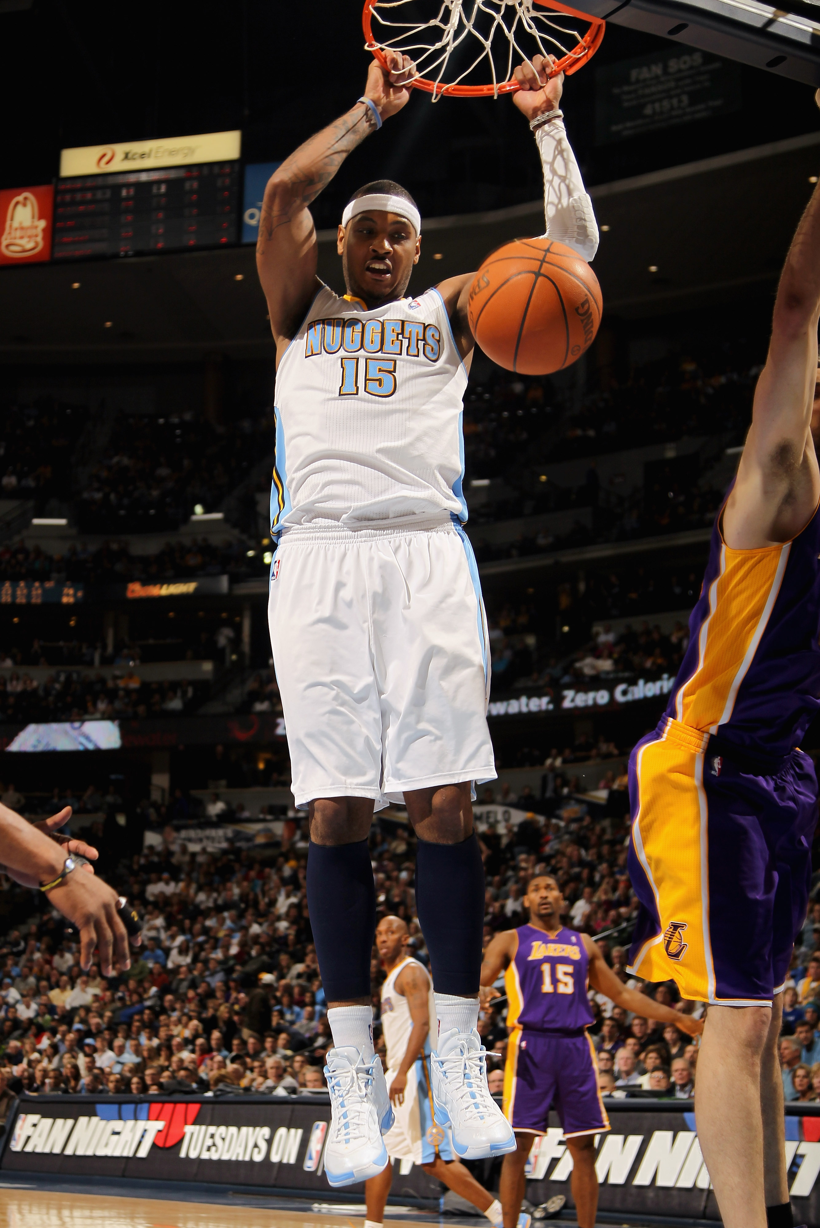 DENVER, CO - JANUARY 21:  Carmelo Anthony #15 of the Denver Nuggets dunks the ball against the Los Angeles Lakers at the Pepsi Center on January 21, 2011 in Denver, Colorado. The Lakers defeated the Nuggets 107-97. NOTE TO USER: User expressly acknowledge