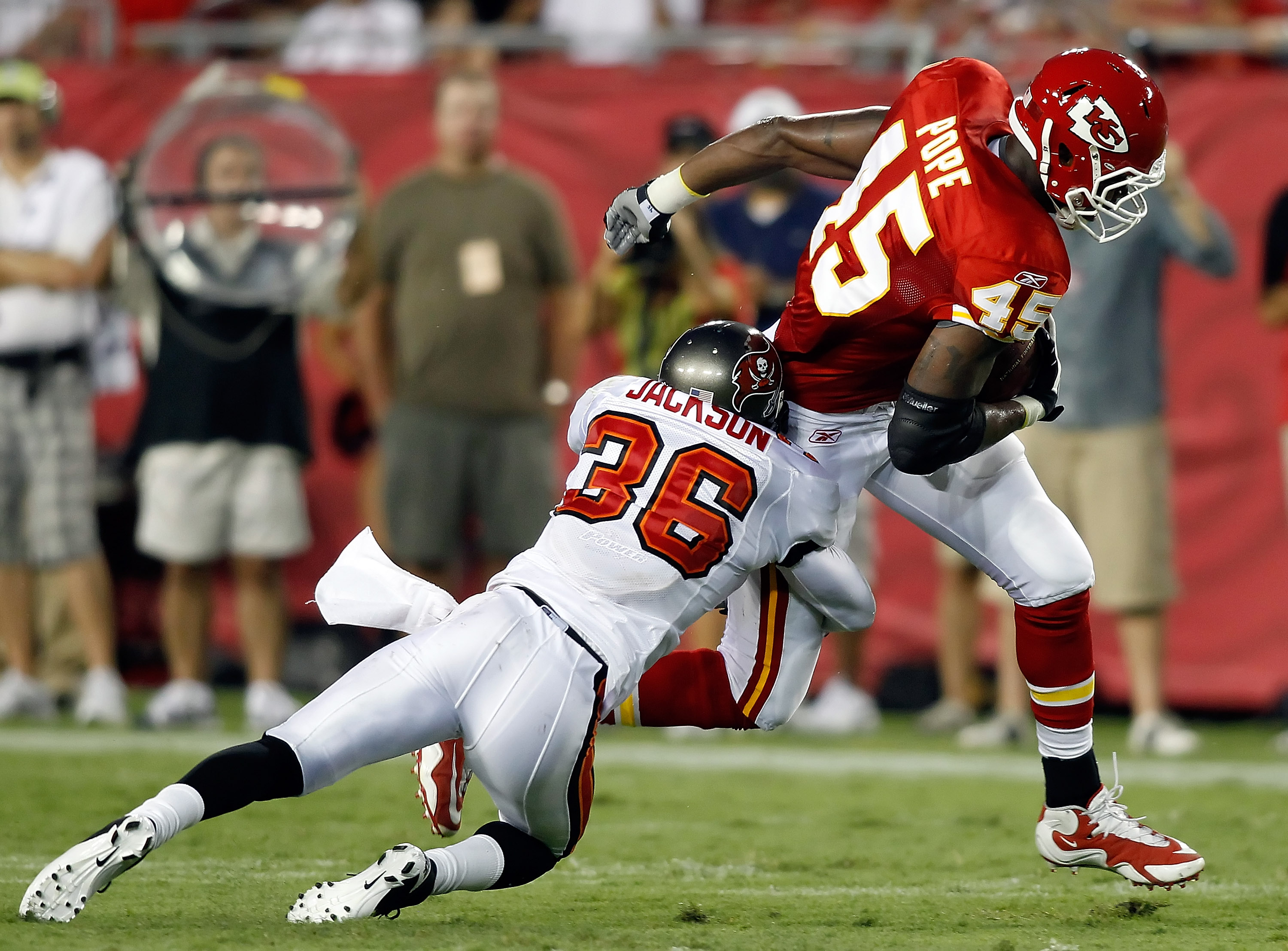 TAMPA, FL - AUGUST 21:  Safety Tanard Jackson #36 of the Tampa Bay Buccaneers tackles tight end Leonard Pope #45 of the Kansas City Chiefs during a preseason game at Raymond James Stadium on August 21, 2010 in Tampa, Florida.  (Photo by J. Meric/Getty Ima