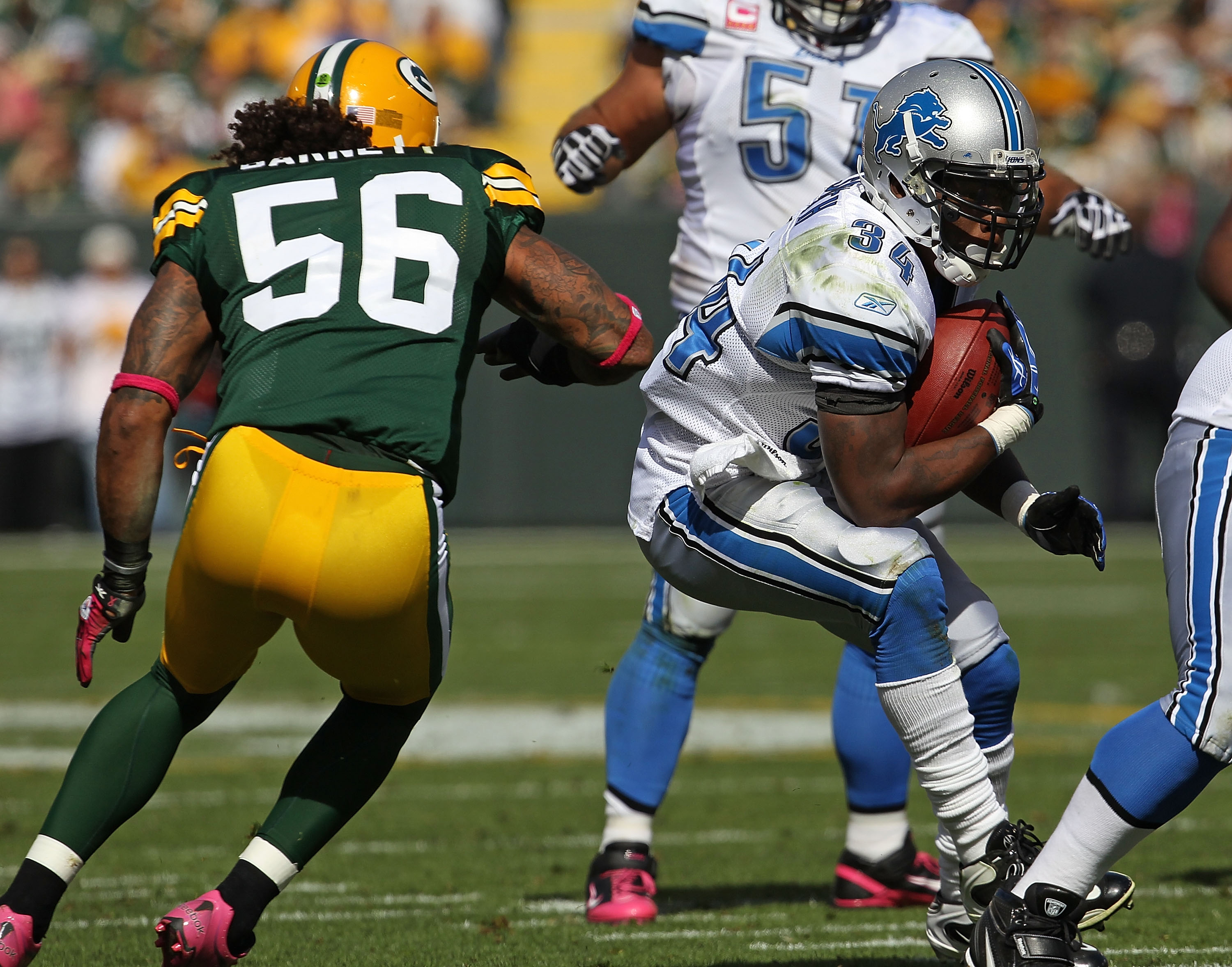 GREEN BAY, WI - OCTOBER 03: Kevin Smith #34 of the Detroit Lions tries to run past Nick Barnett #56 of the Green Bay Packers at Lambeau Field on October 3, 2010 in Green Bay, Wisconsin. The Packers defeated the Lions 28-26. (Photo by Jonathan Daniel/Getty
