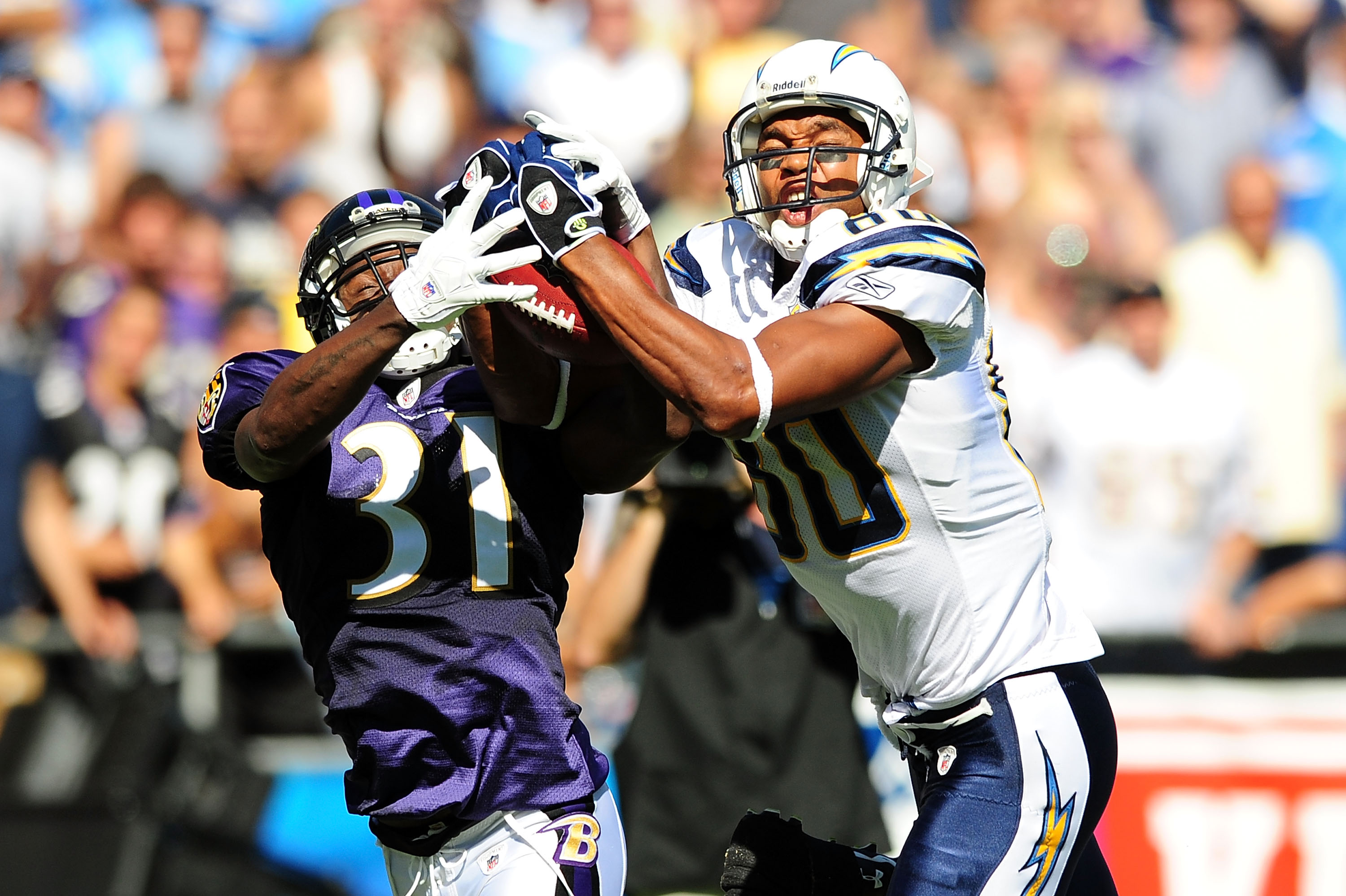SAN DIEGO - SEPTEMBER 20:Malcolm Floyd #80 of the San Diego Chargers and Fabian Washington #31 of the Baltimore Ravens both catch the ball  at Qualcomm Stadium on September 20, 2009 in San Diego, California.  (Photo by Jacob de Golish/Getty Images)