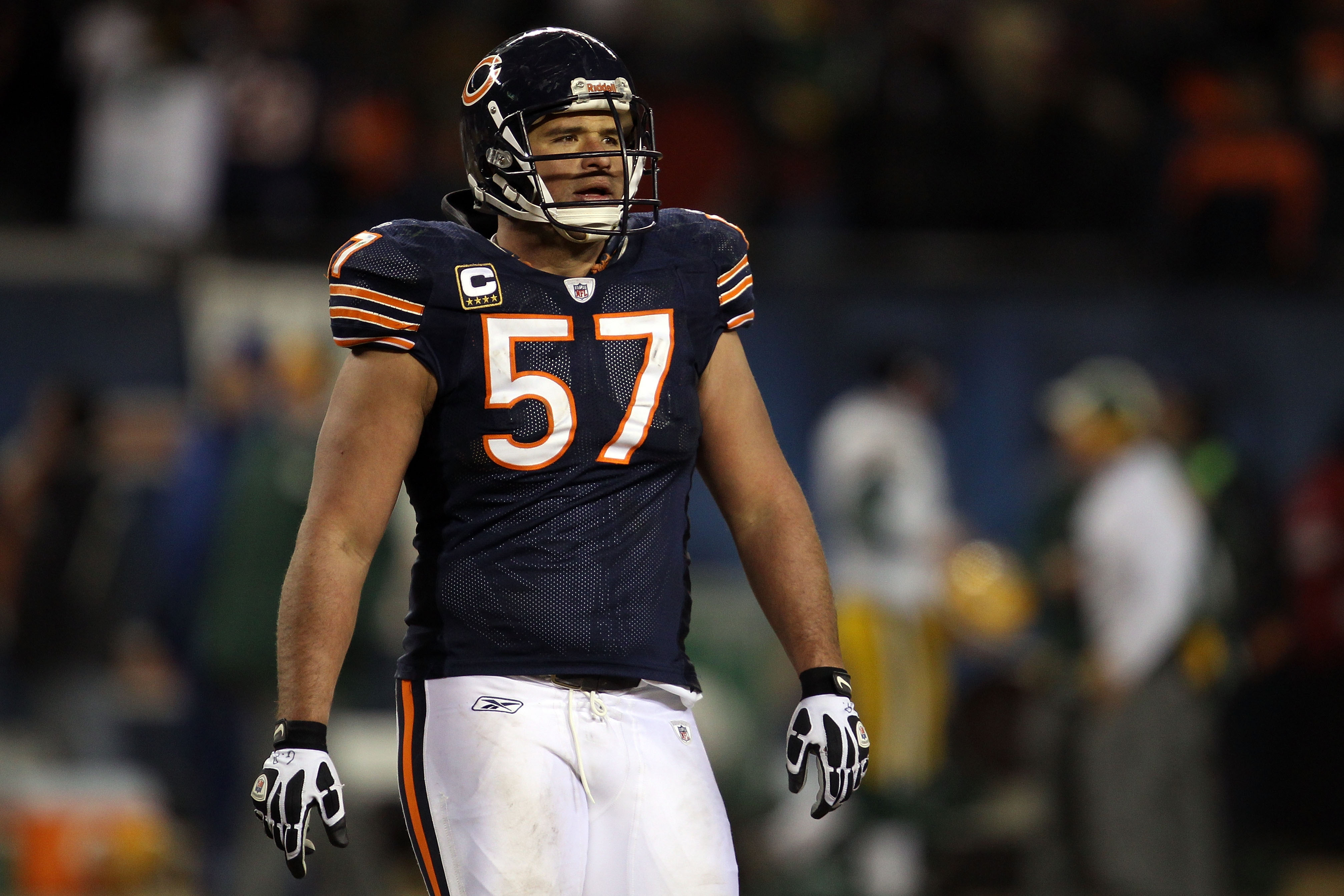 CHICAGO, IL - JANUARY 23:  Olin Kreutz #57 of the Chicago Bears looks on late in the fourth quarter against the Green Bay Packers in the NFC Championship Game at Soldier Field on January 23, 2011 in Chicago, Illinois.  (Photo by Jonathan Daniel/Getty Imag