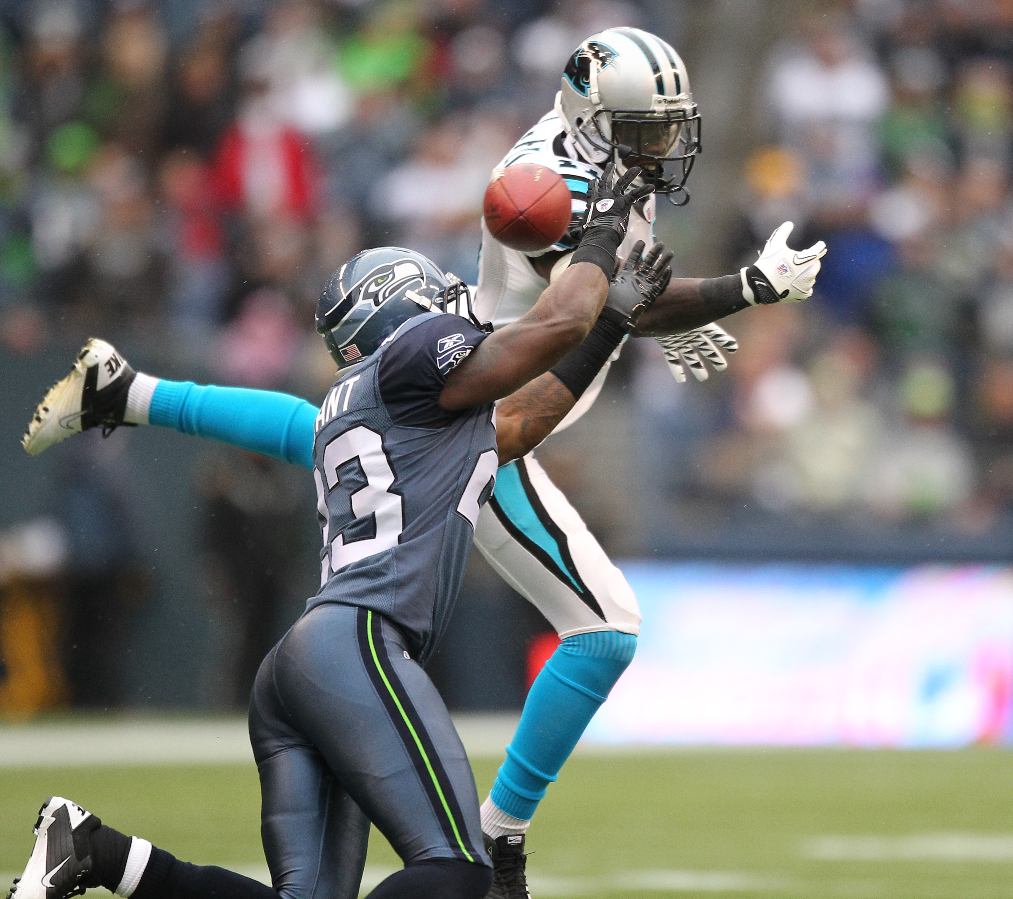 SEATTLE - DECEMBER 05:  Wide receiver Brandon LaFell #11 of the Carolina Panthers just misses this pass against Marcus Trufant #23 of the Seattle Seahawks at Qwest Field on December 5, 2010 in Seattle, Washington. The Seahawks won, 31-14. (Photo by Otto G