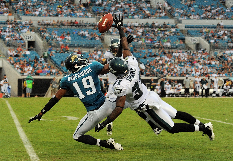 JACKSONVILLE, FL - SEPTEMBER 26:  Cornerback Ellis Hobbs #31 of the Philadelphia Eagles knocks down a pass intended for wide receiver Tiquan Underwood #19 of the Jacksonville Jaguars at EverBank Field on September 26, 2010 in Jacksonville, Florida. The Ea