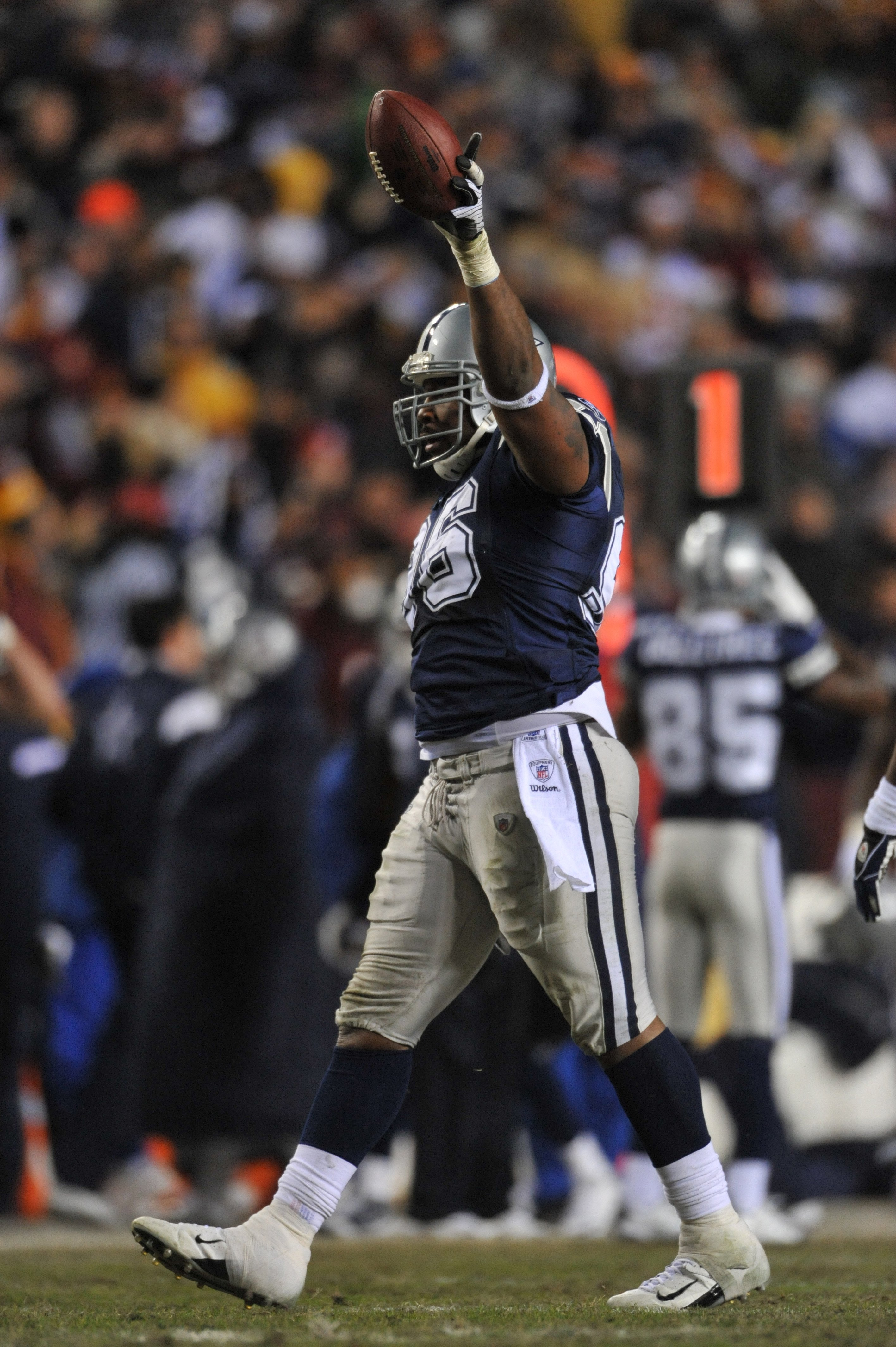 LANDOVER, MD - DECEMBER 27:  Marcus Spears #96 of the Dallas Cowboys celebrates the recovery of the ball during the game against the Washington Redskins at FedExField on December 27, 2009 in Landover, Maryland. The Cowboys defeated the Redskins 17-0. (Pho
