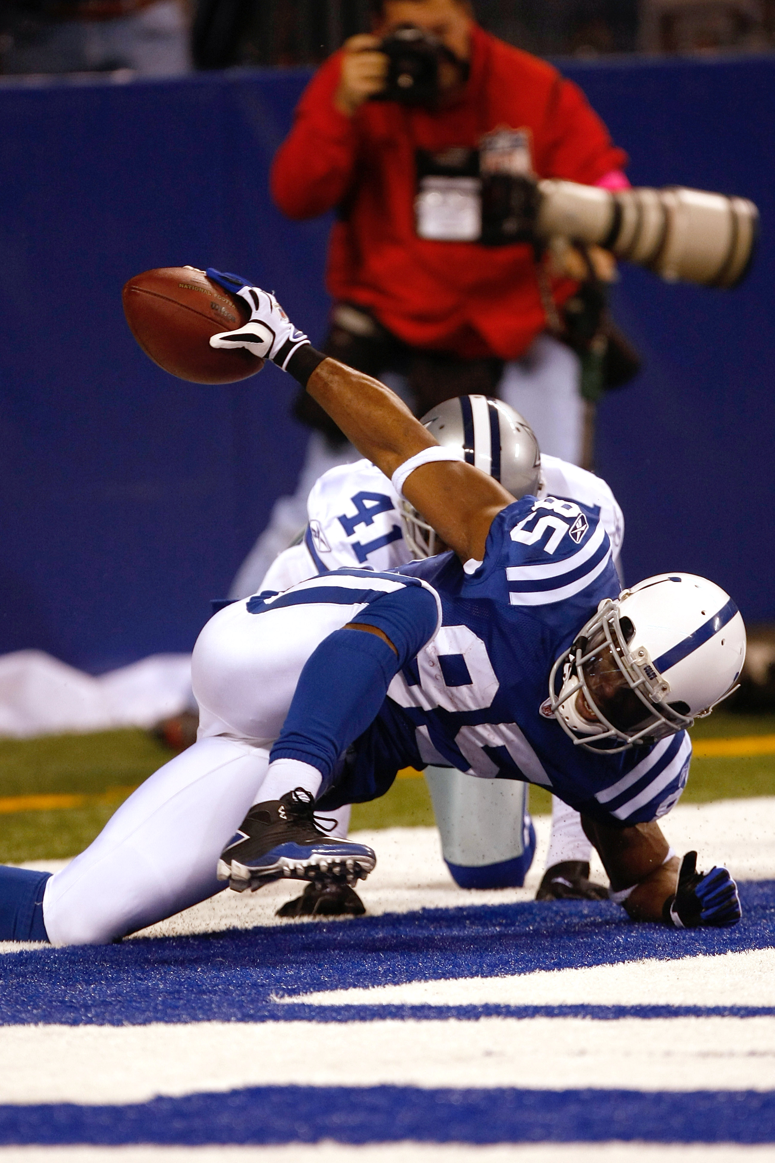 INDIANAPOLIS, IN - DECEMBER 05: Pierre Garcon #85 of the Indianapolis Colts scores a touchdown as Terrence Newman #41 of the Dallas Cowboys defends at Lucas Oil Stadium on December 5, 2010 in Indianapolis, Indiana.  (Photo by Scott Boehm/Getty Images)
