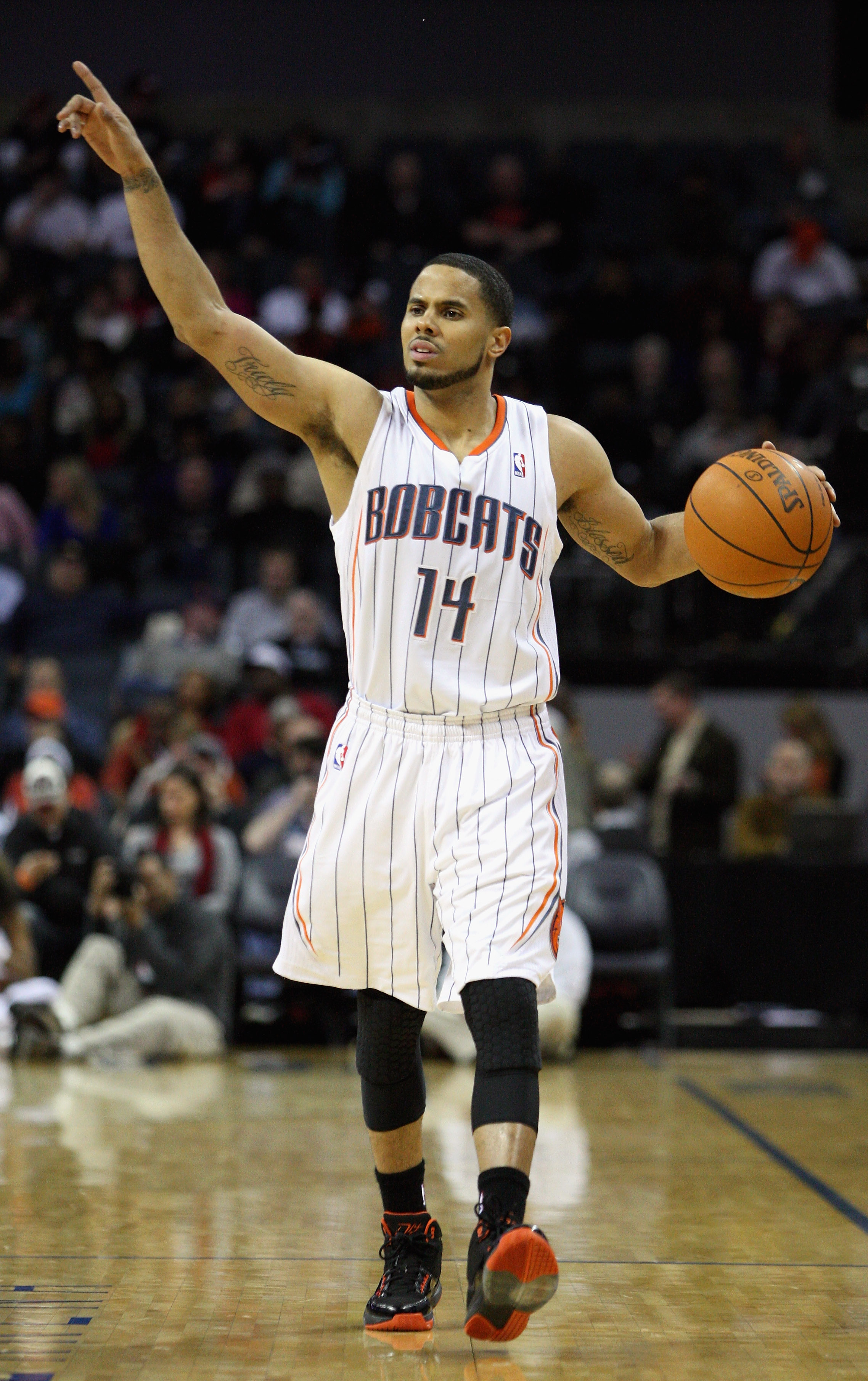 CHARLOTTE, NC - JANUARY 12:  D.J. Augustin #14 of the Charlotte Bobcats calls a play against the Chicago Bulls during their game at Time Warner Cable Arena on January 12, 2011 in Charlotte, North Carolina. NOTE TO USER: User expressly acknowledges and agr