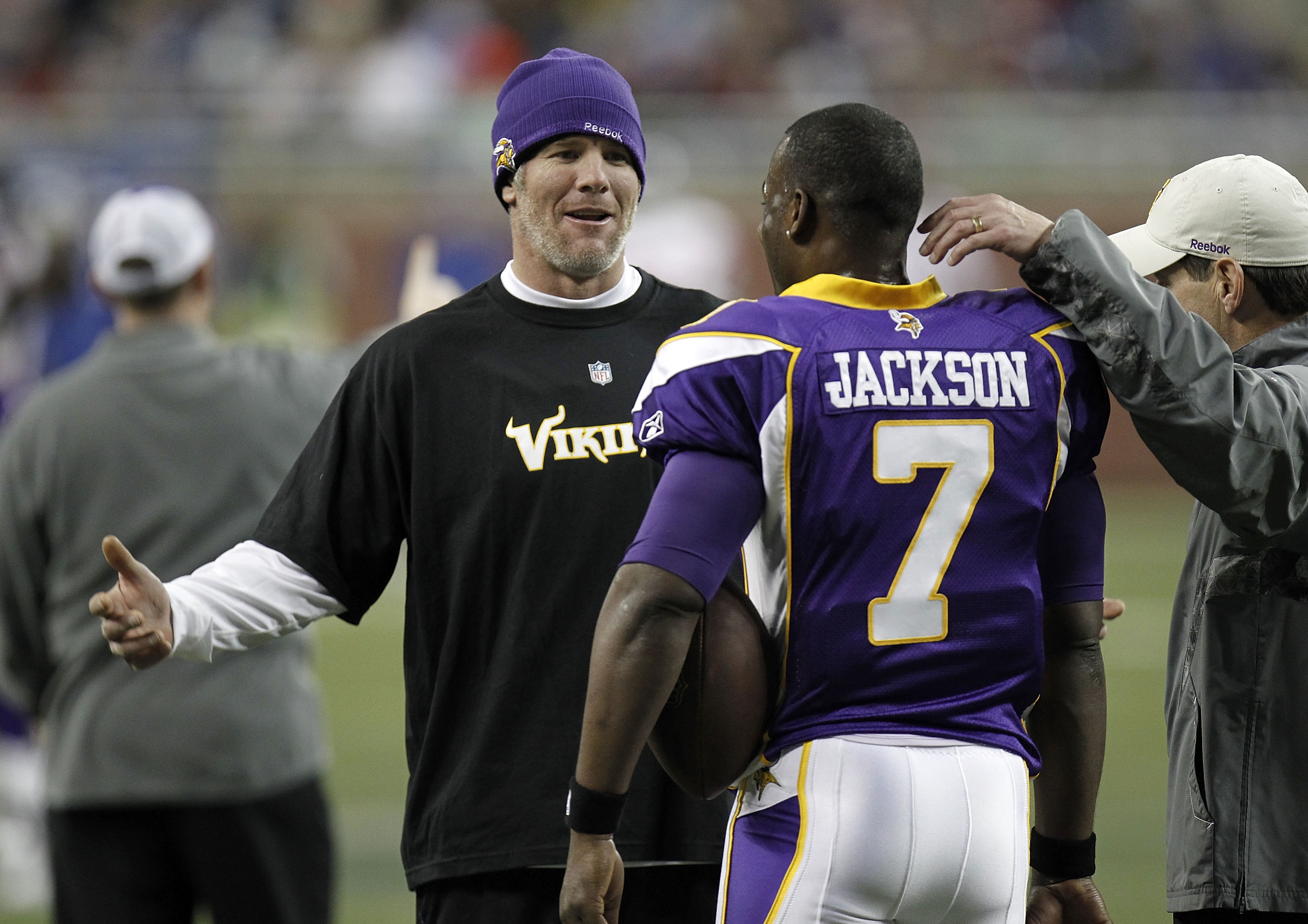 DETROIT, MI - DECEMBER 13:  Brett Favre #4 of the Minnesota Vikings talks with Tarvaris Jackson #7 during warm ups prior to playing the New York Giants at Ford Field on December 13, 2010 in Detroit, Michigan.  (Photo by Gregory Shamus/Getty Images)