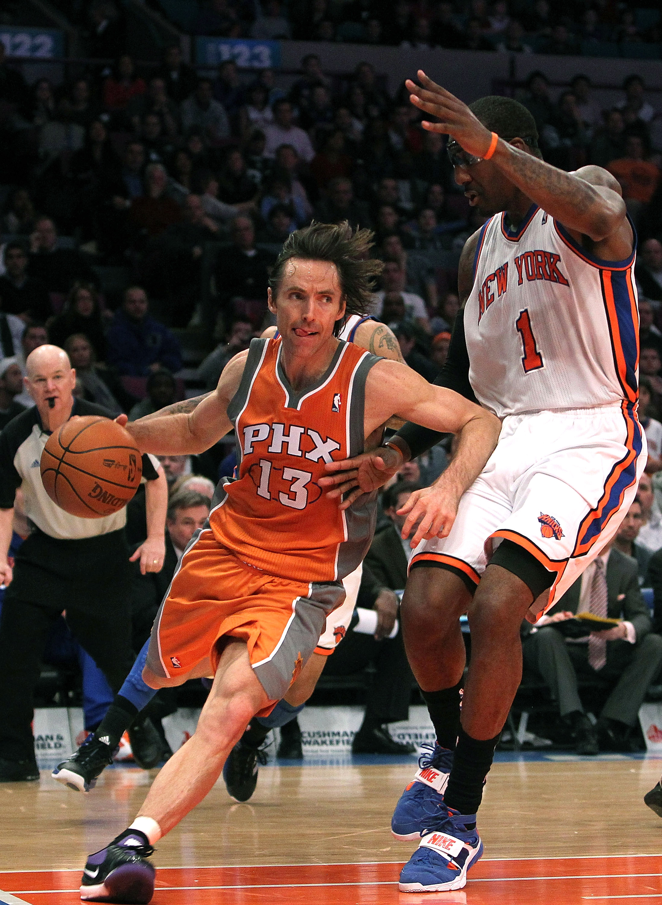 NEW YORK, NY - JANUARY 17:  Steve Nash #13 of the Phoenix Suns drives to the basket against Amar'e Stoudemire #1 of the New York Knicks at Madison Square Garden on January 17, 2011 in New York City. NOTE TO USER: User expressly acknowledges and agrees tha