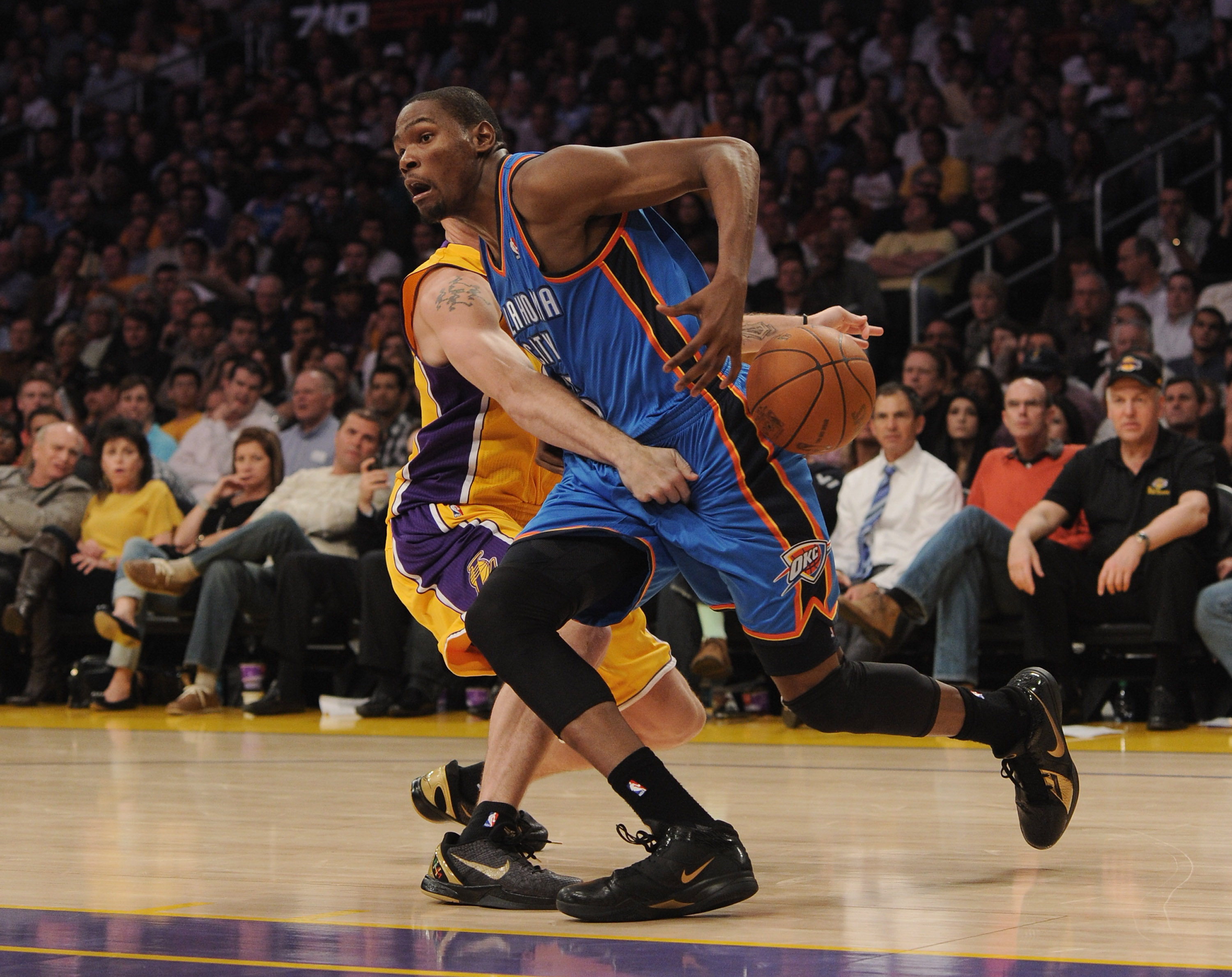 LOS ANGELES, CA - JANUARY 17:  Kevin Durant #35 of the Oklahoma City Thunder has the ball knocked away by Luke Walton #4 of the Los Angeles Lakers at the Staples Center on January 17, 2011 in Los Angeles, California.   NOTE TO USER: User expressly acknowl