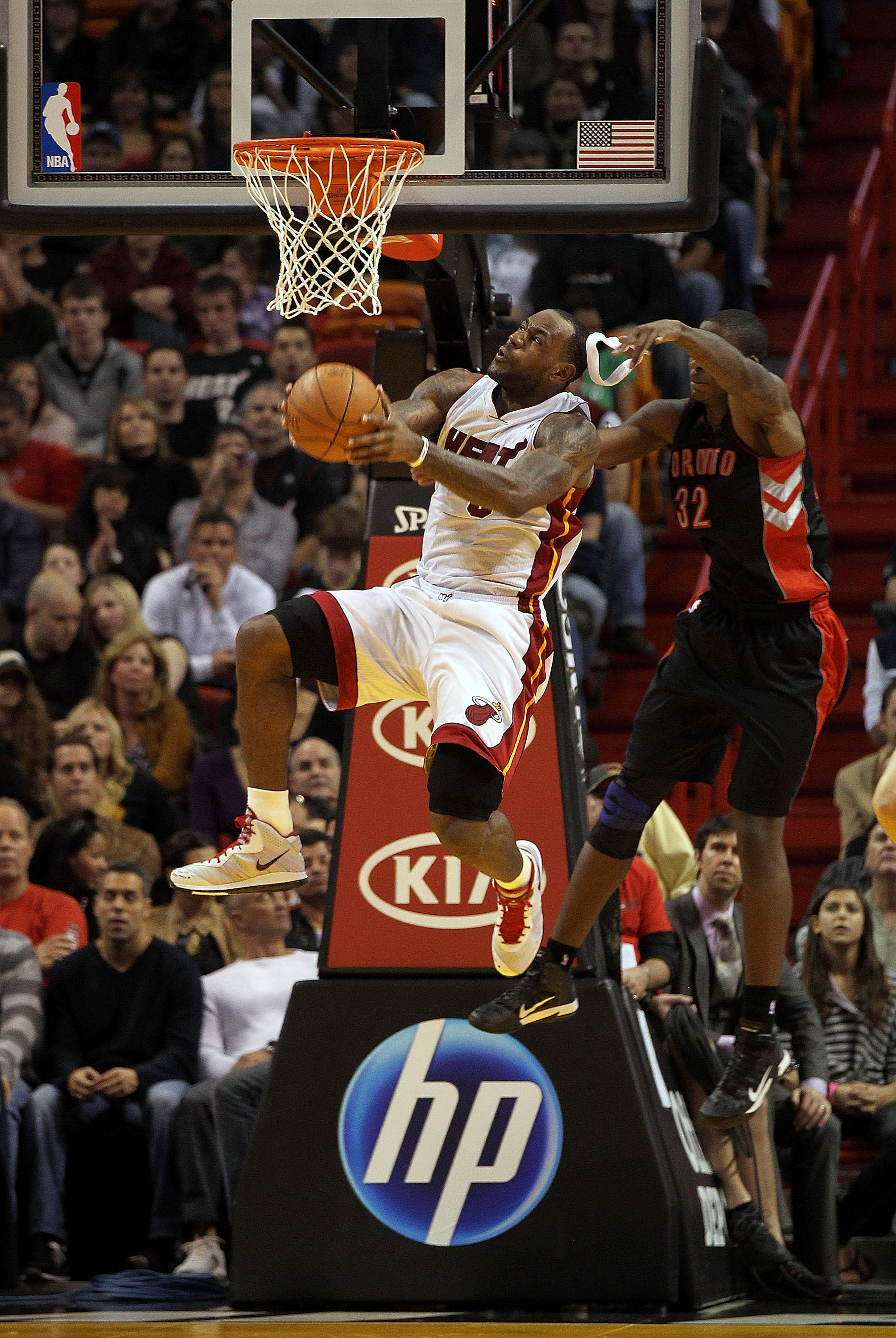 MIAMI, FL - JANUARY 22:  LeBron James #6 of the Miami Heat is fouled by Ed Davis #32 of the Toronto Raptors during a game  at American Airlines Arena on January 22, 2011 in Miami, Florida. NOTE TO USER: User expressly acknowledges and agrees that, by down