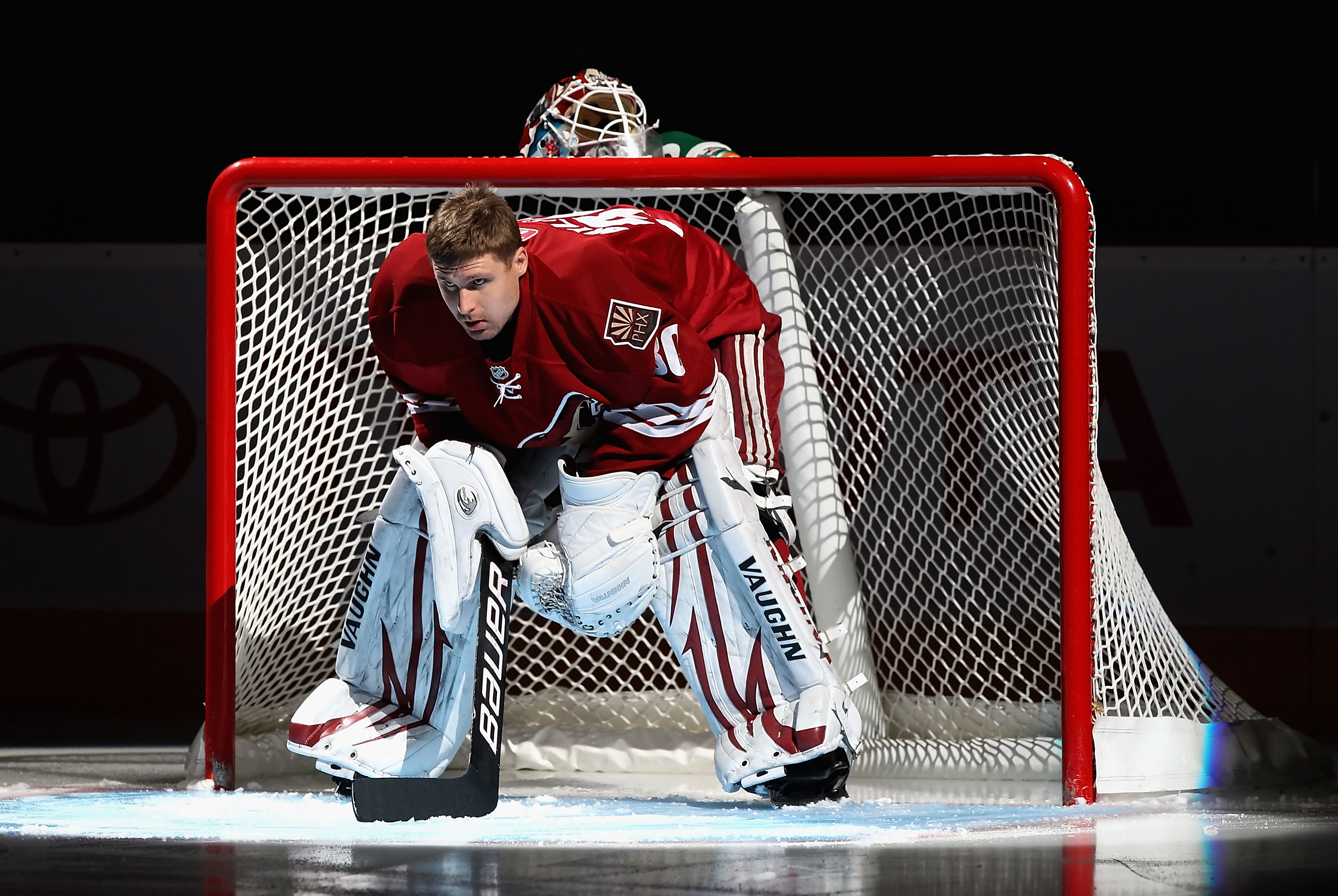 GLENDALE, AZ - JANUARY 22:  Goaltender Ilya Bryzgalov #30 of the Phoenix Coyotes is introduced before the NHL game against the Los Angeles Kings at Jobing.com Arena on January 22, 2011 in Glendale, Arizona.  The Kings defeated the Coyotes 4-3. (Photo by C